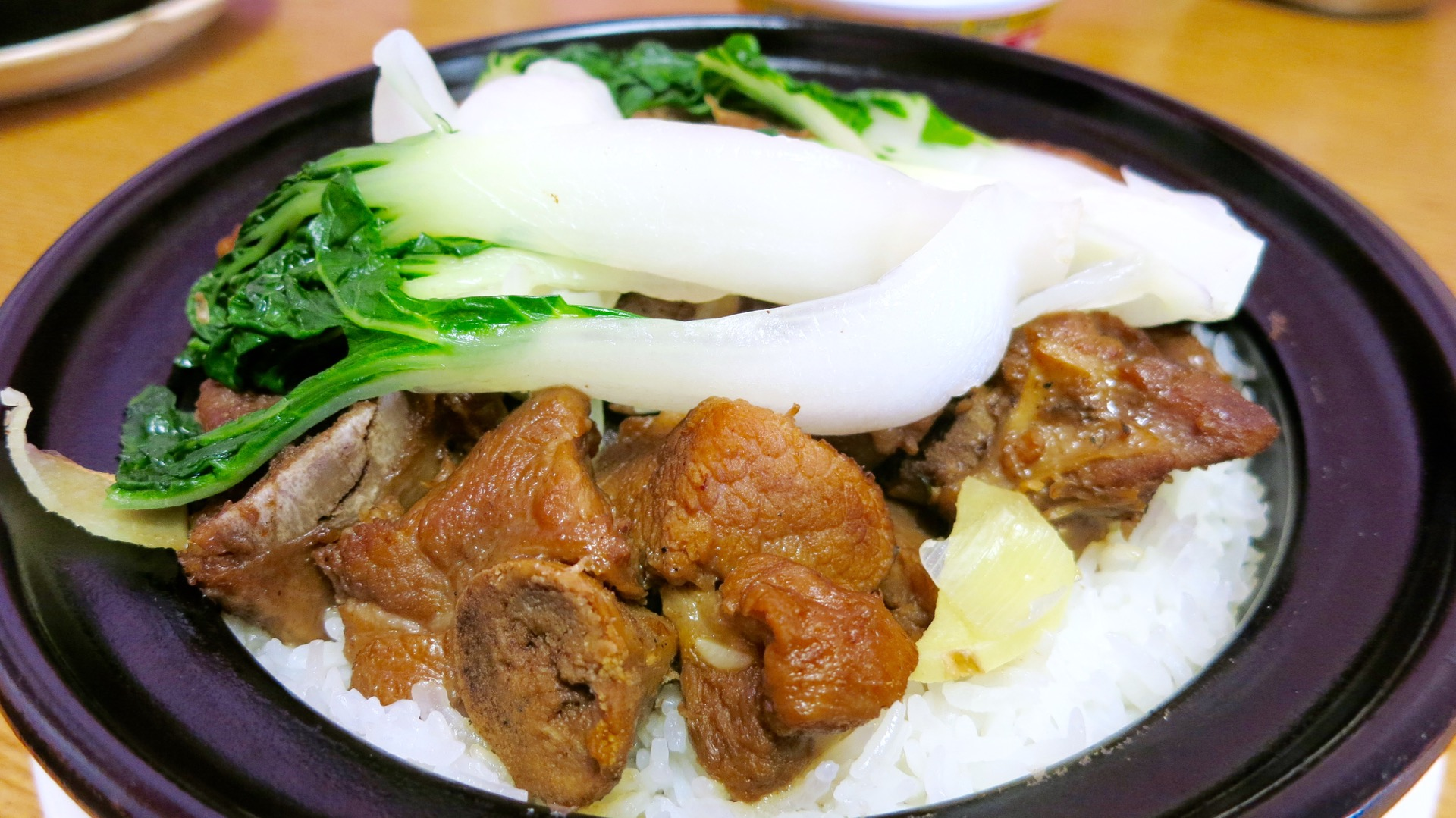 Gum Wah's pork spareribs in black bean sauce over sticky rice is an affordable and filling lunch.