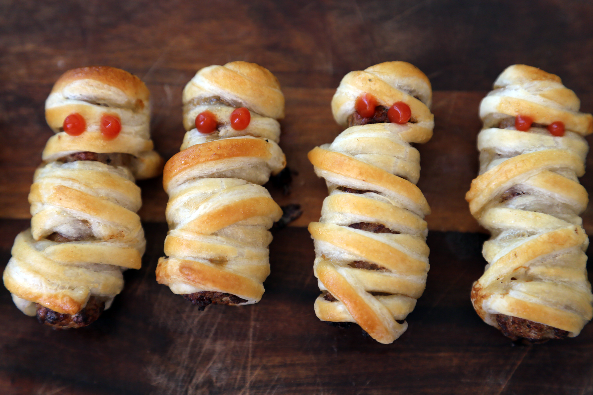 Serve the Mummy Sausage Rolls at once.