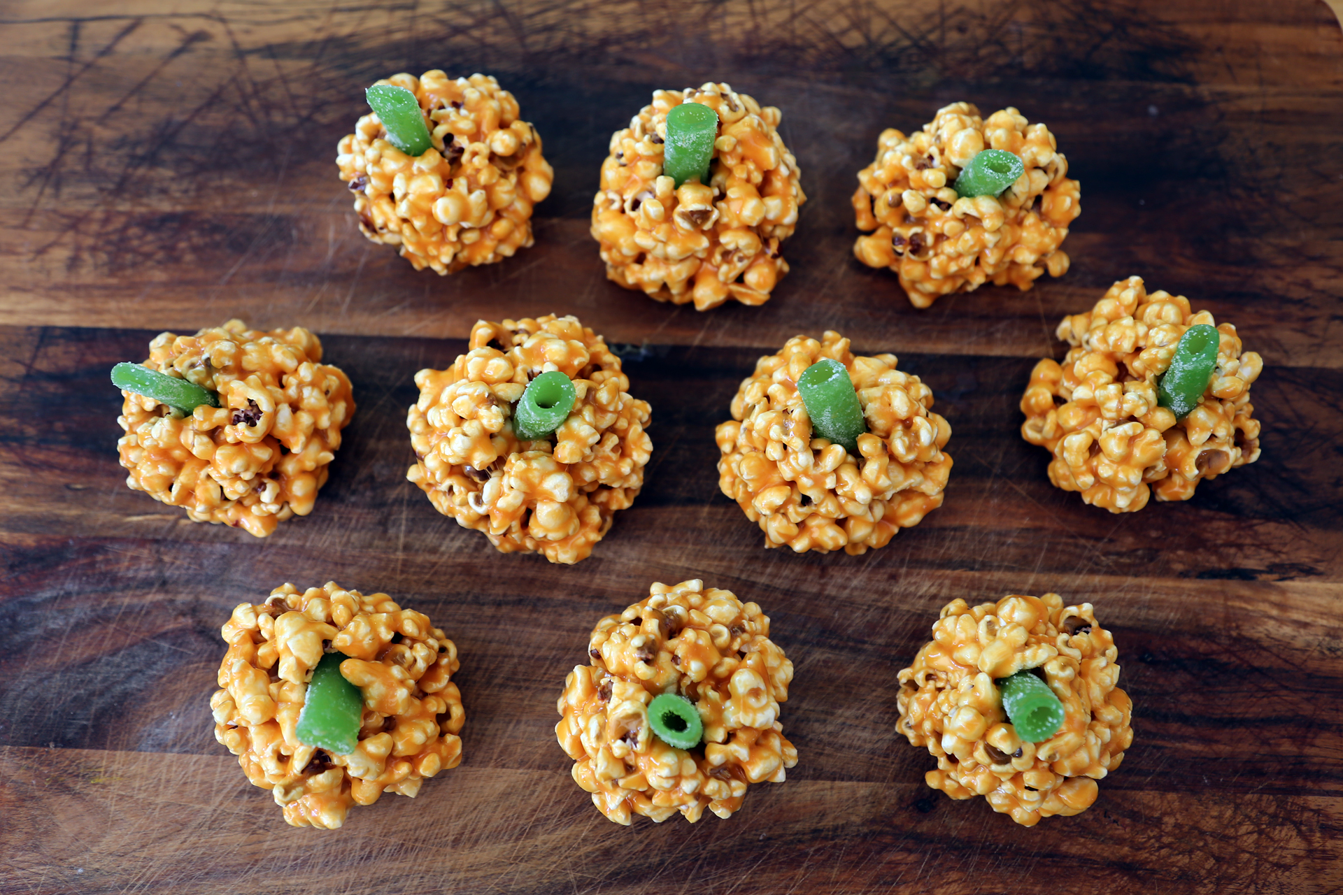 Salted Caramel Popcorn Jack-O-Lanterns With Green Candy Stems