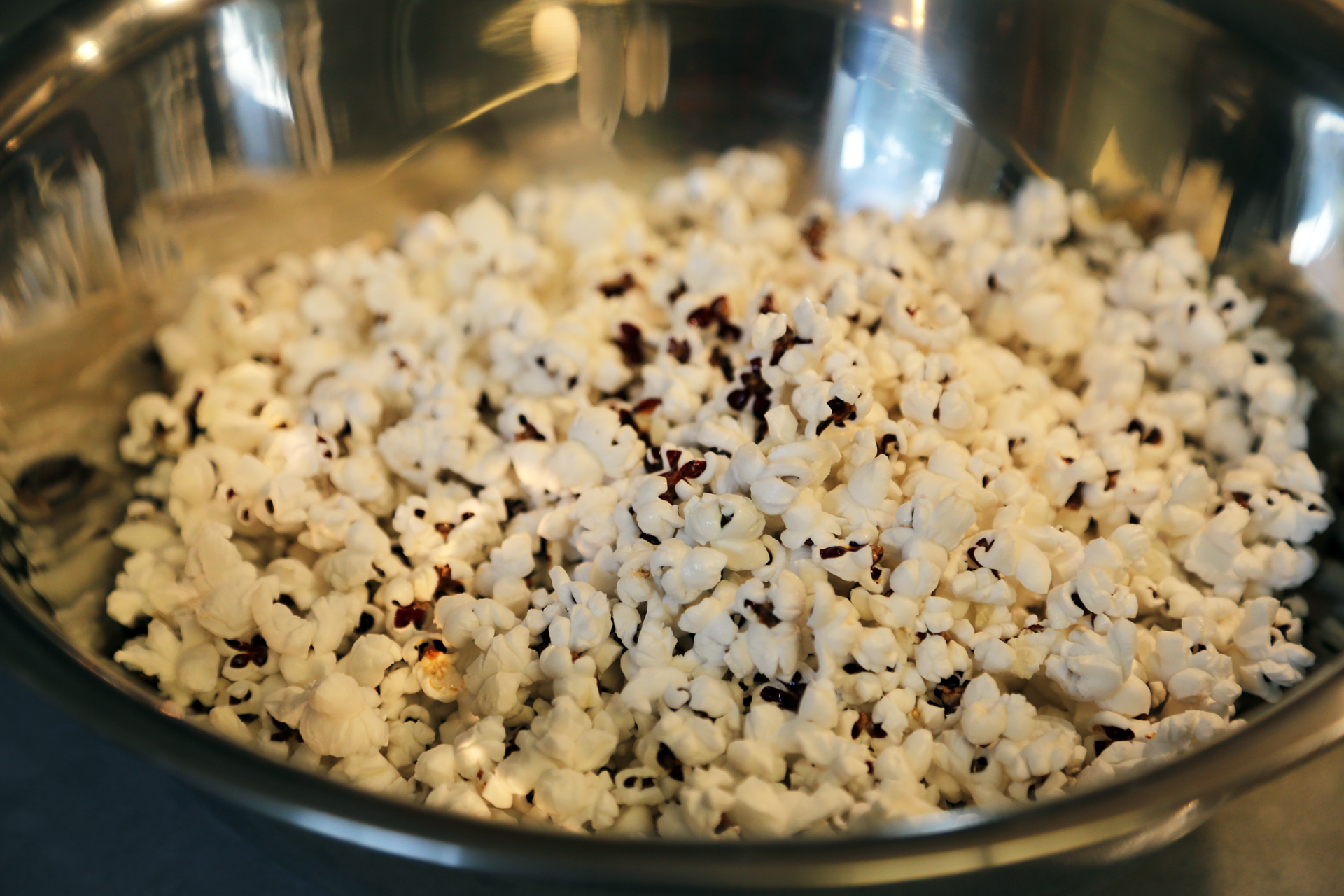 Pop the popcorn according to package directions, transfer to a large mixing bowl.