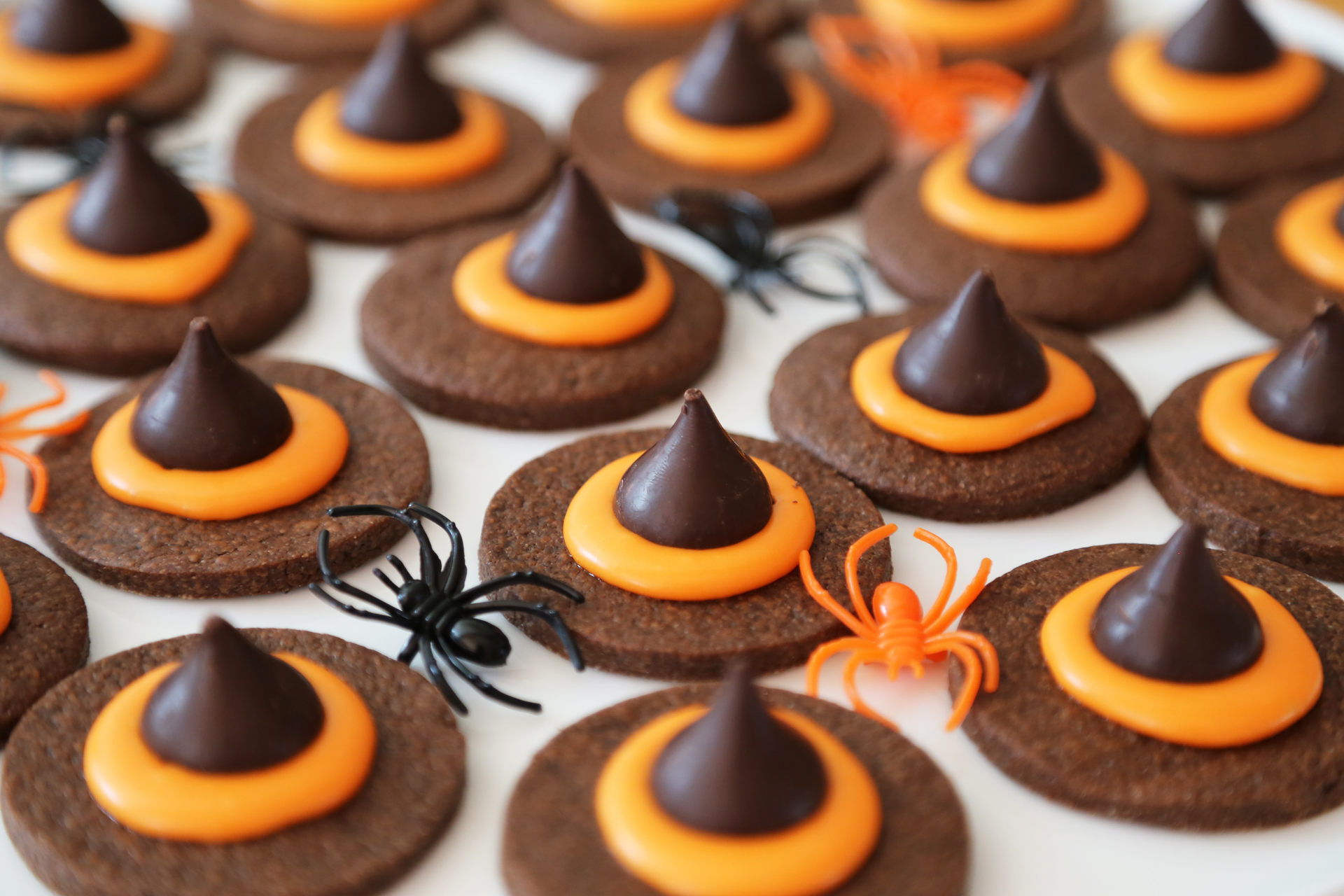 Serve the Wicked Witch Hat Cookies with spiders.