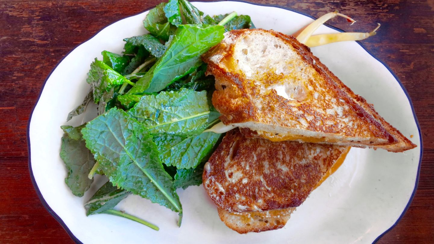 Grand Lake Kitchen's grilled cheddar cheese sandwich on sourdough is simple yet satisfying. Jenny Oh