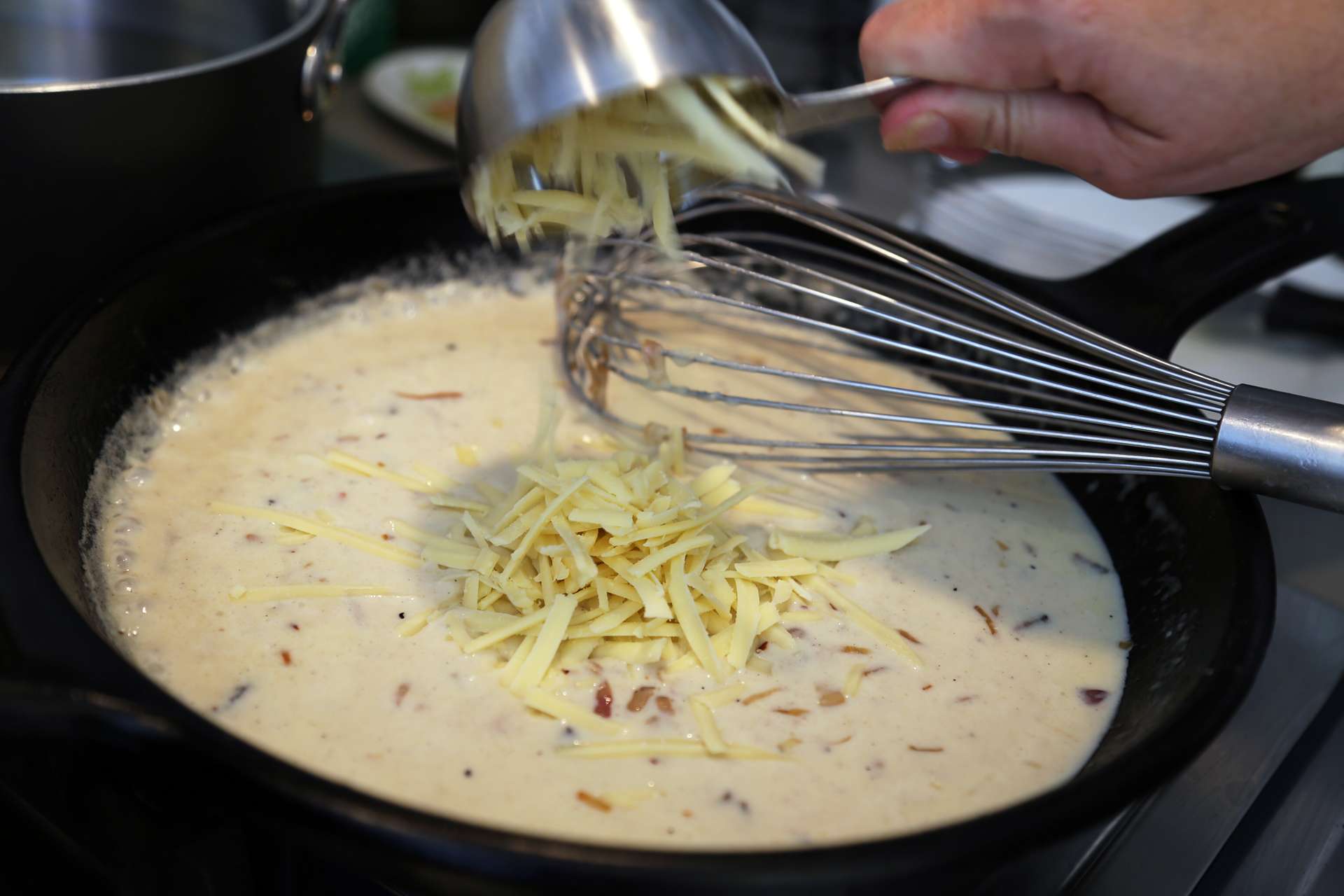 Add 1/2 cup of the cheese and stir until smooth.
