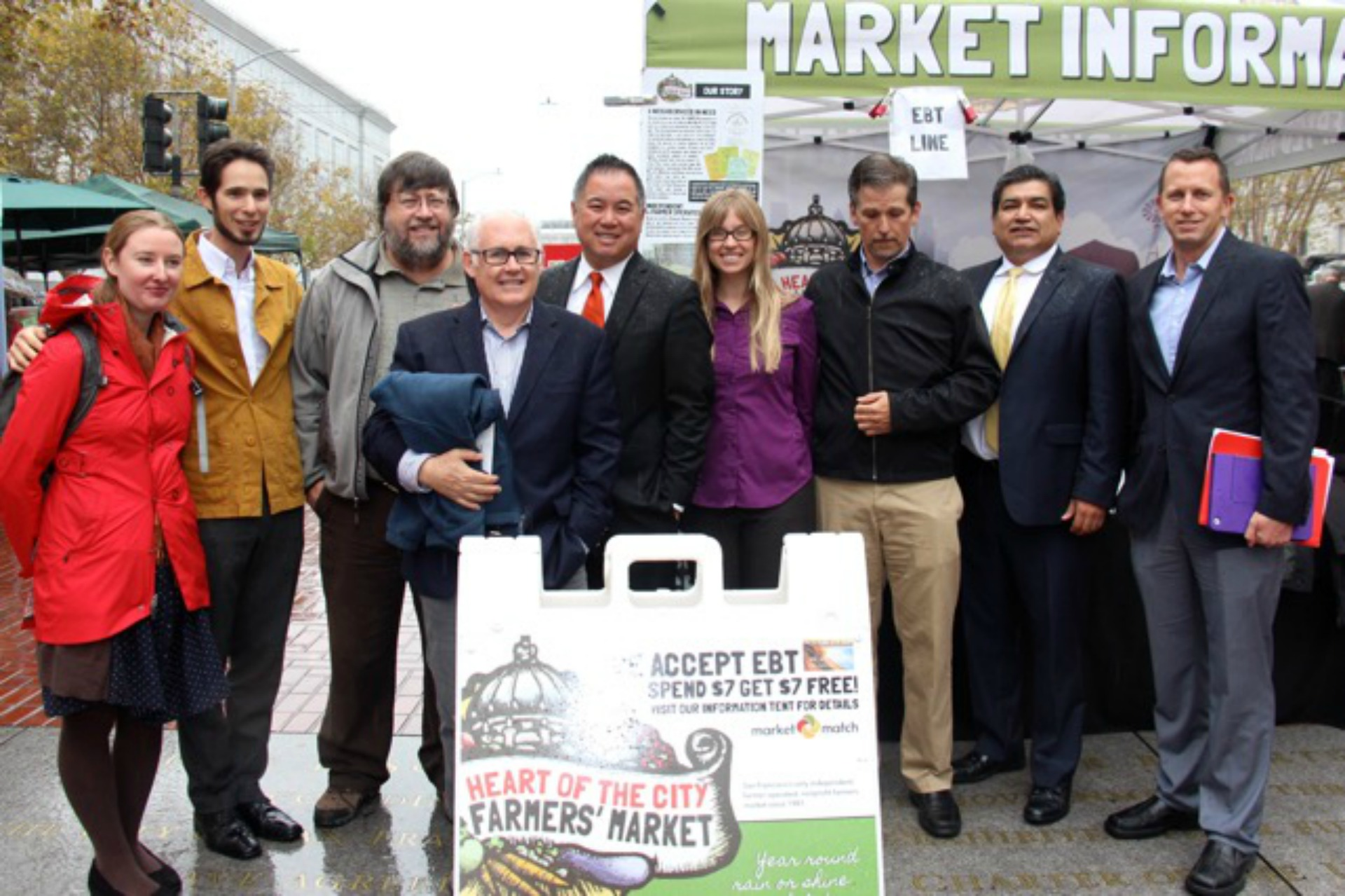 Celebrating the passage of nutrition incentive matching legislation AB 1321 at Heart of the City Farmers Market in September. From left: Christina Oatfield, Eli Zigas, Peter Ruddock, Michael Dimock, Assemblymember Phil Ting, Kate Creps, Martin Bourque, Xavier Morales, Allen Moy.