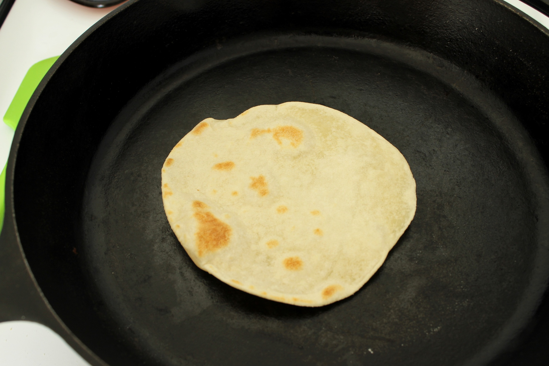 Each side of the tortilla should have golden brown spots.