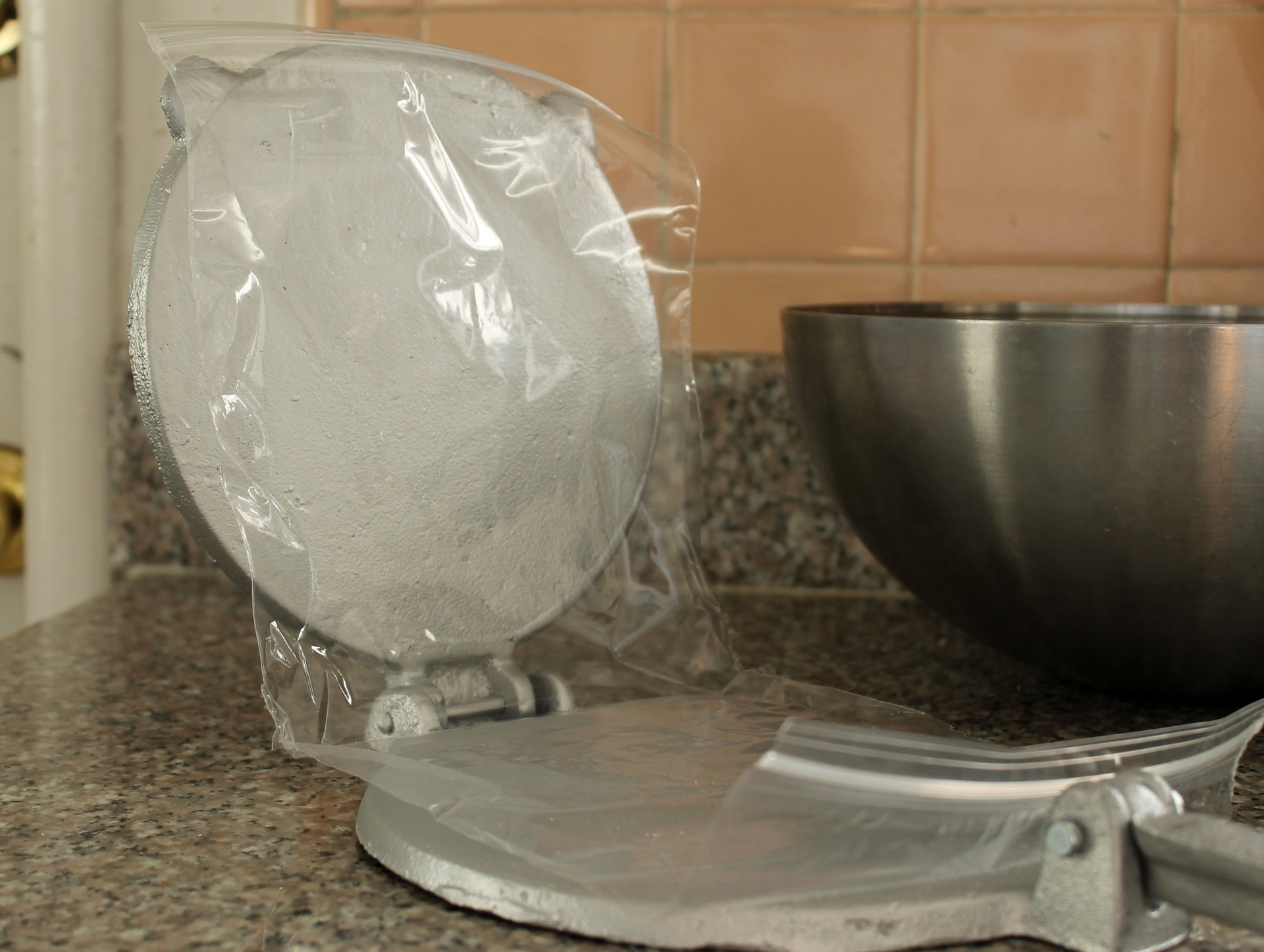 Line the tortilla press with an opened zipper lock bag.