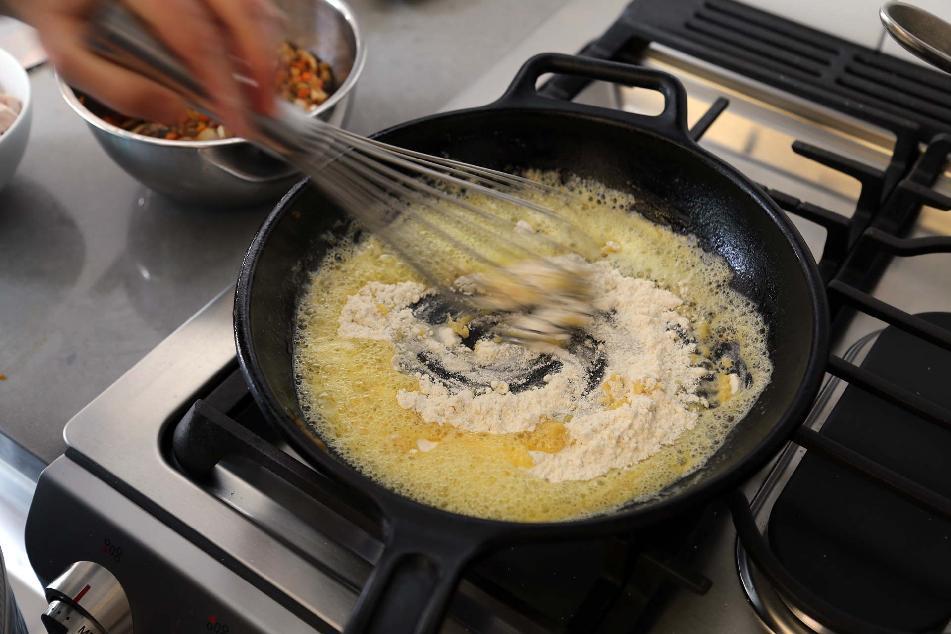 Add the remaining 5 tbsp butter to the frying pan. When melted, sprinkle in the flour.
