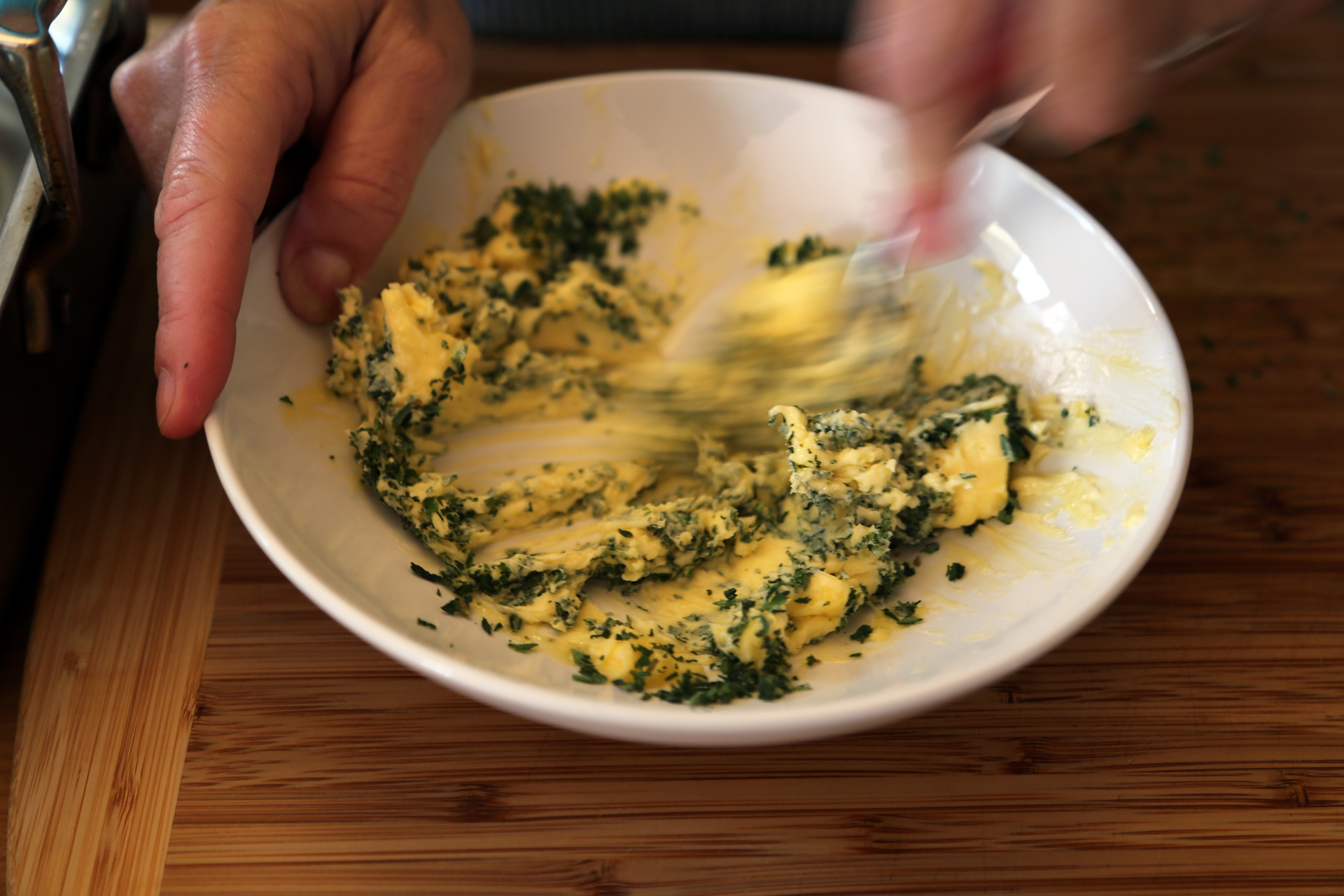 In a bowl, stir together the butter, thyme, and sage until well combined.