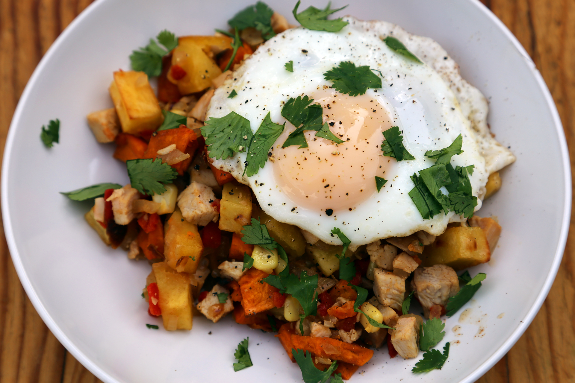 Morning-After Turkey Breakfast Hash with Sweet Potatoes and Roasted Peppers (and a fried egg!).