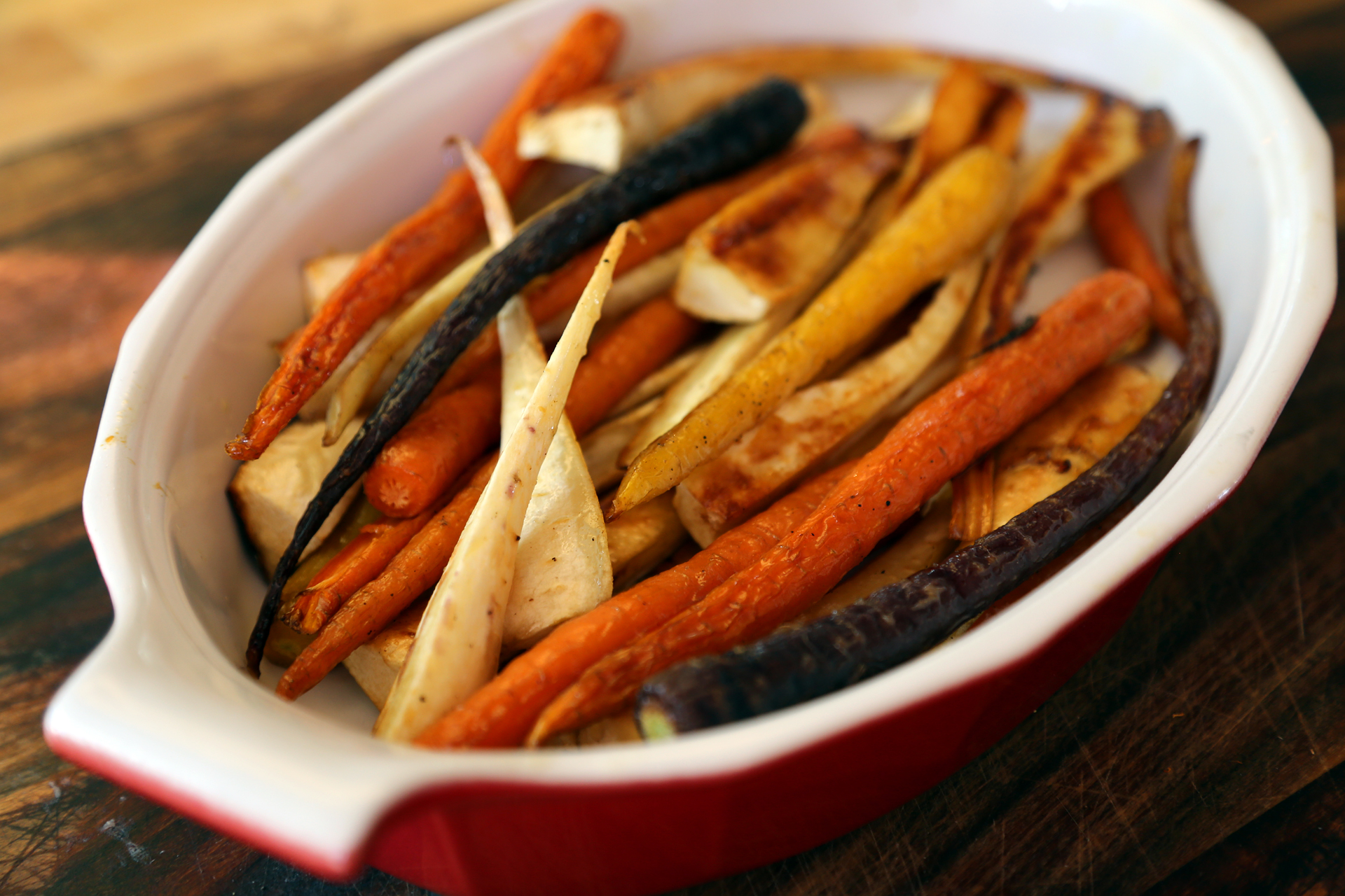 Serve the Honey-Roasted Carrots and Parsnips right away.