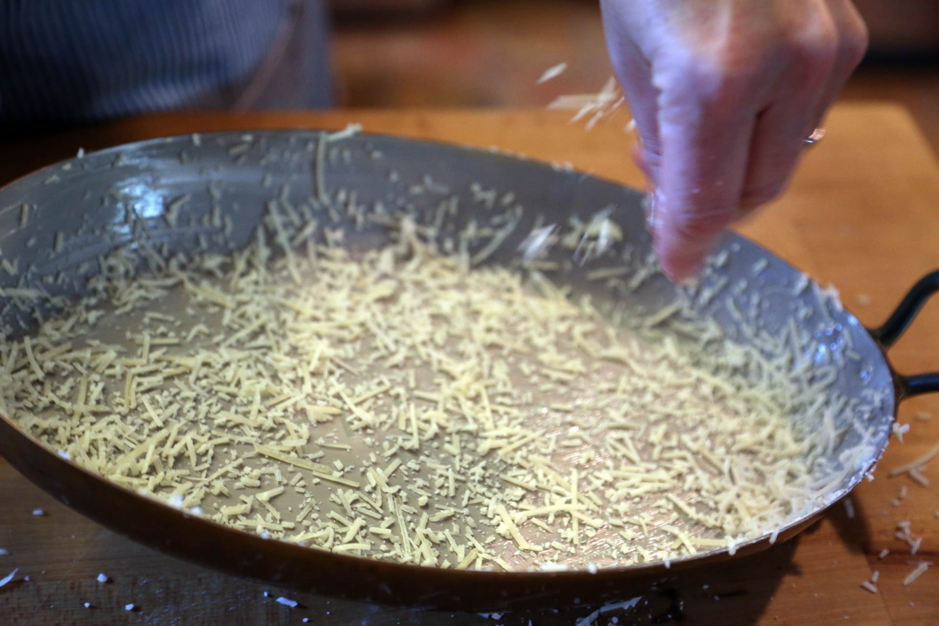 Grease a 2-quart shallow baking dish with the butter, then sprinkle with the Parmesan.