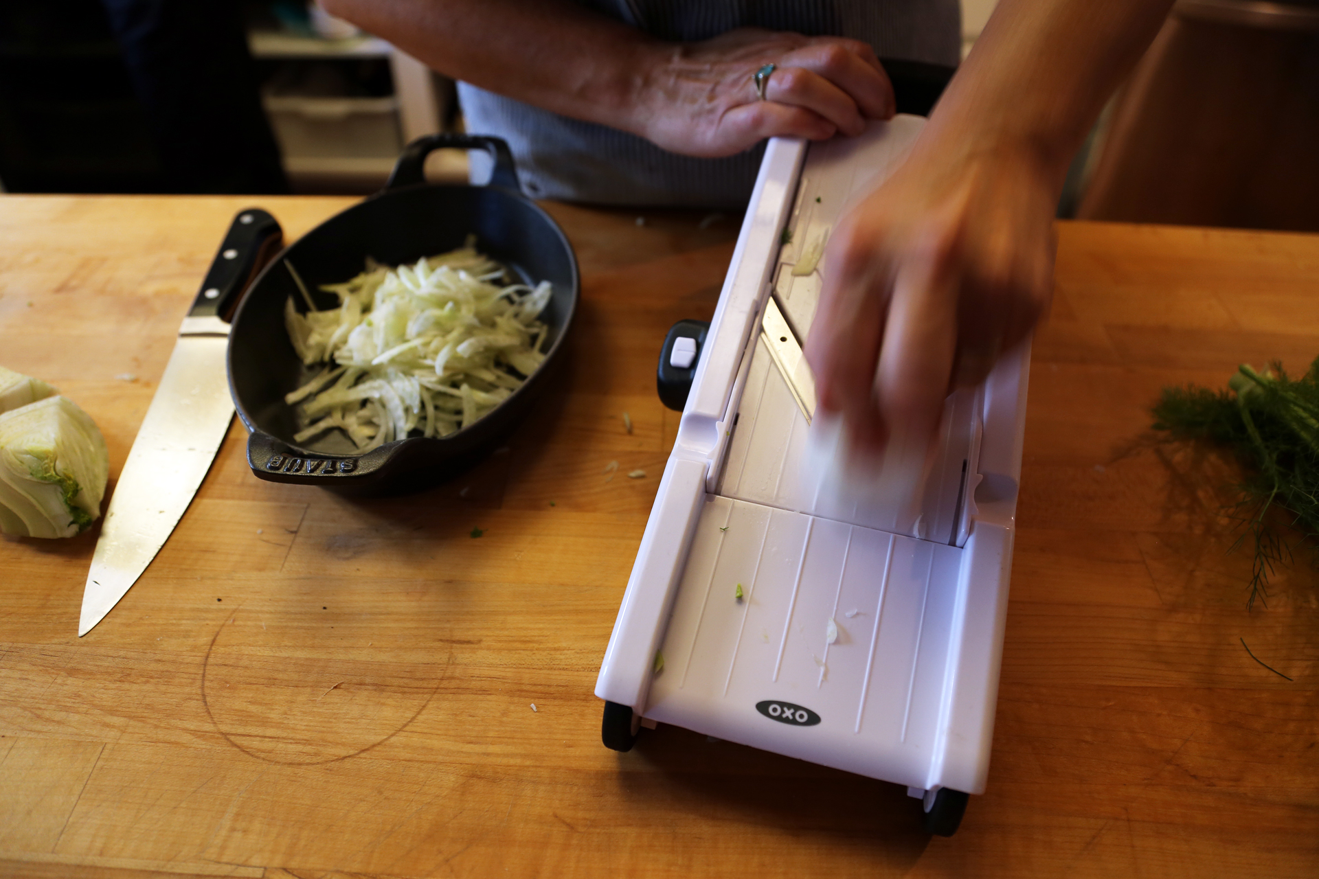 If you have a mandoline, that's the best tool to use to get paper-thin slices.