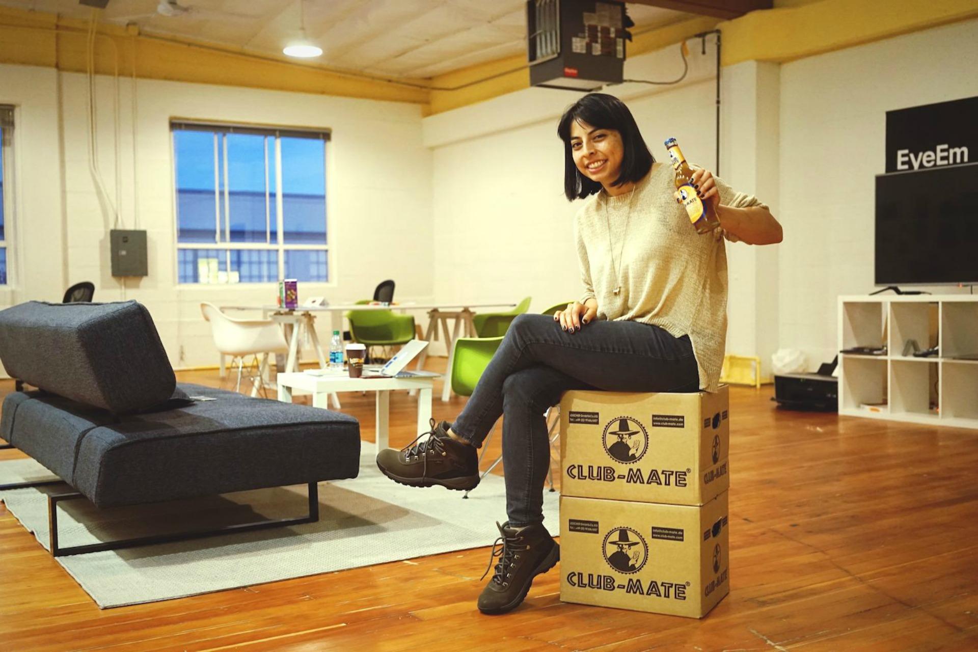 Lisbeth Ortega, EyeEm SF's blog editor with the company's stock's of Club Mate.