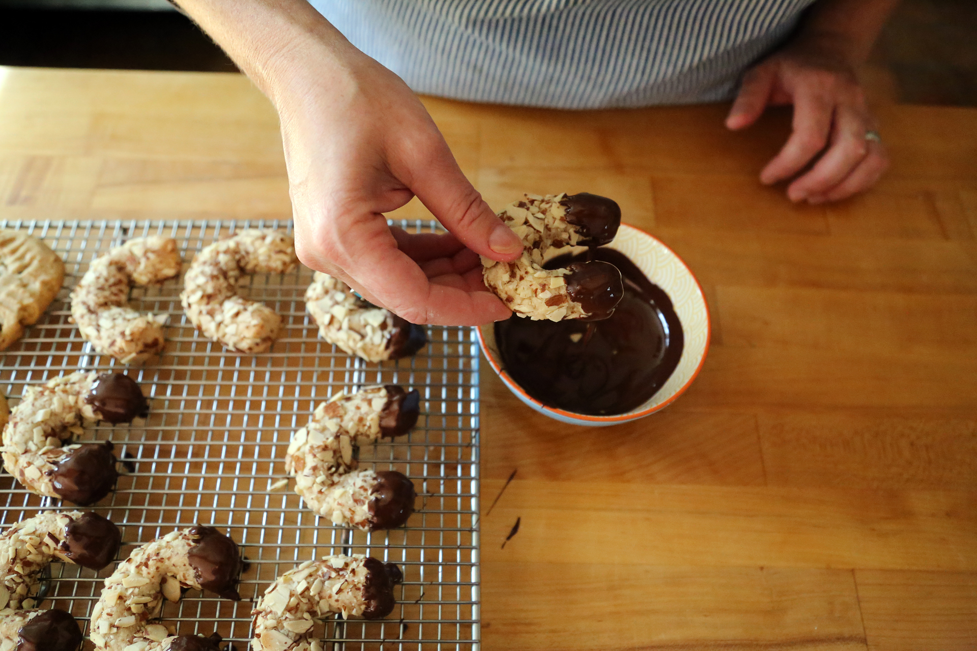 Dip the ends or the base of the cooled cookies into the chocolate, then let dry on parchment, waxed paper or a wire rack.