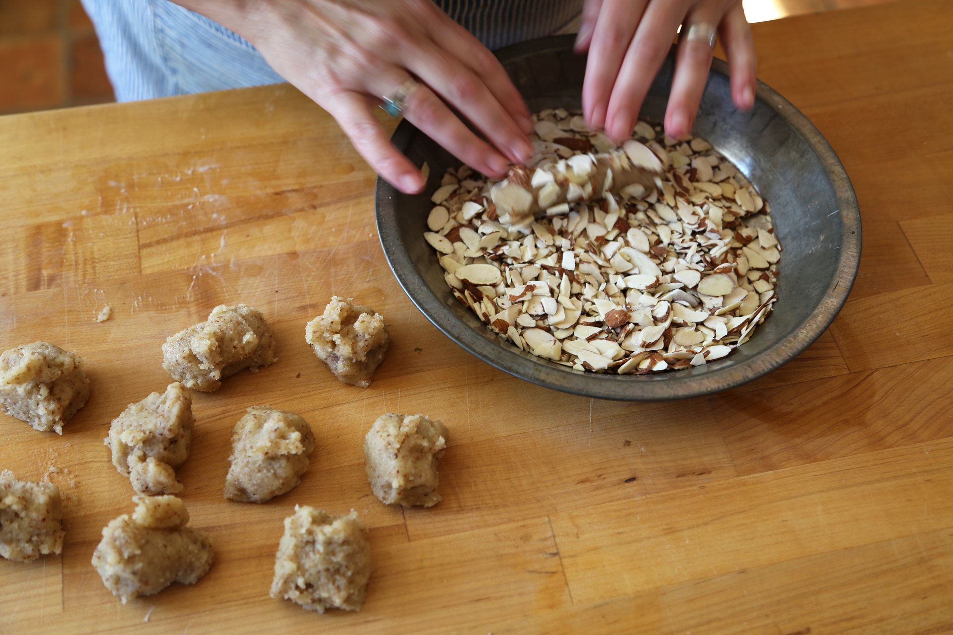 Roll the logs into the crushed sliced almonds.