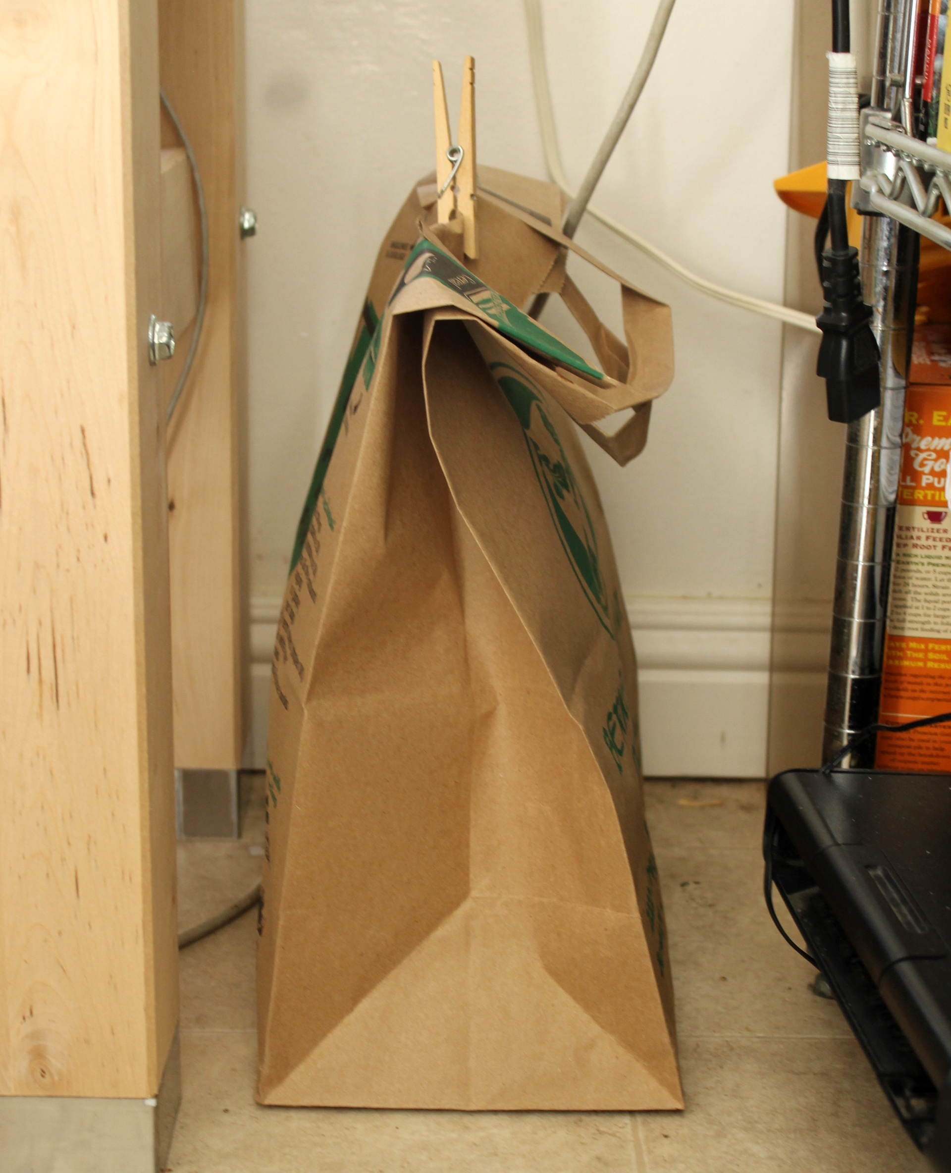 Place the bottles in a paper bag or cardboard box to carbonate in darkness.