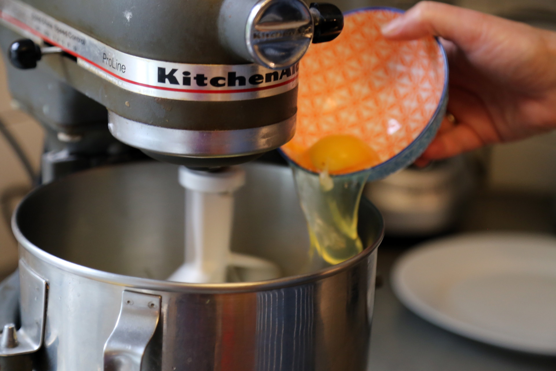In the bowl of a stand mixer fitted with the paddle attachment, beat the butter, sugar, and lemon zest until smooth, about 2 minutes. Scrape down the sides of the bowl and add the eggs one at a time, beating well after each addition, until the egg is fully incorporated.