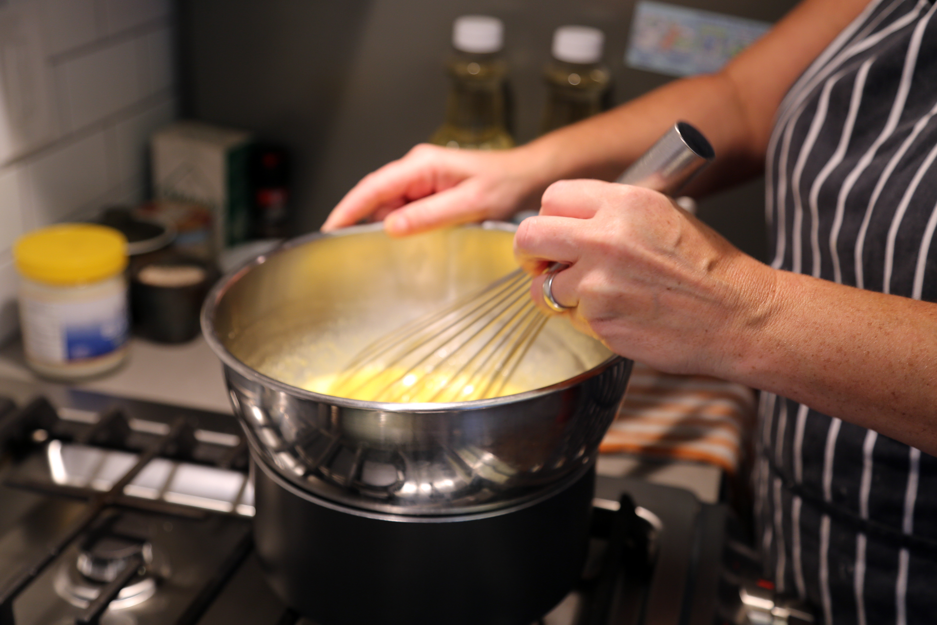 To make the lemon curd, in a heatproof bowl set over (but not touching) barely simmering water in a saucepan, whisk together the ingredients.