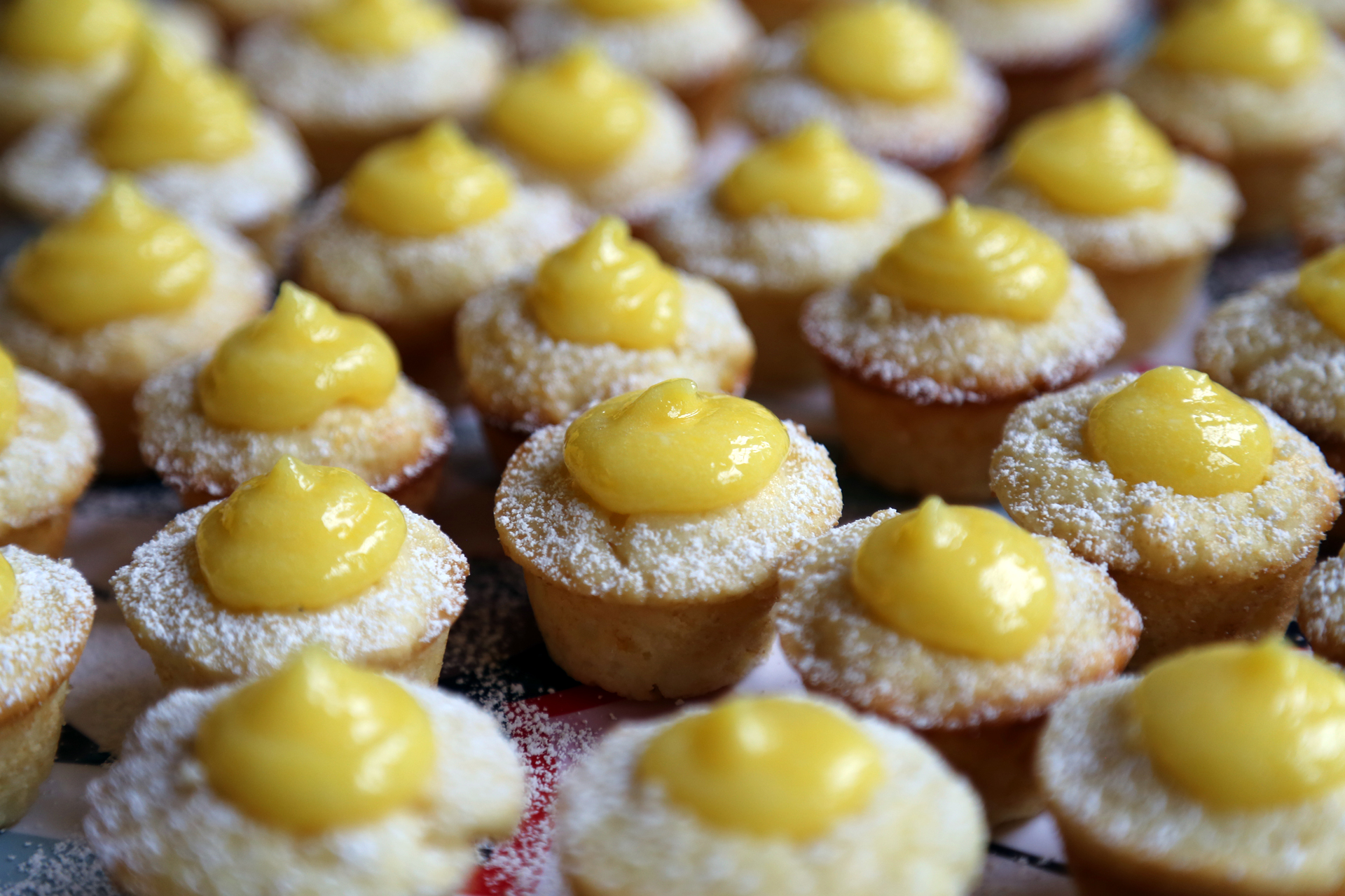 Serve the Mini Meyer Lemon Curd Cupcakes at once.