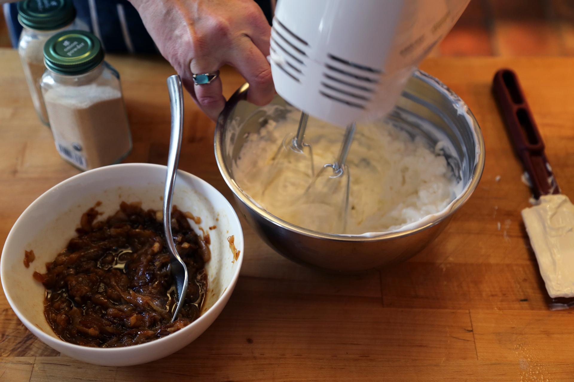 Add the sour cream and cream cheese to a mixing bowl and beat with an electric hand mixer or a wooden spoon until smooth and well combined.