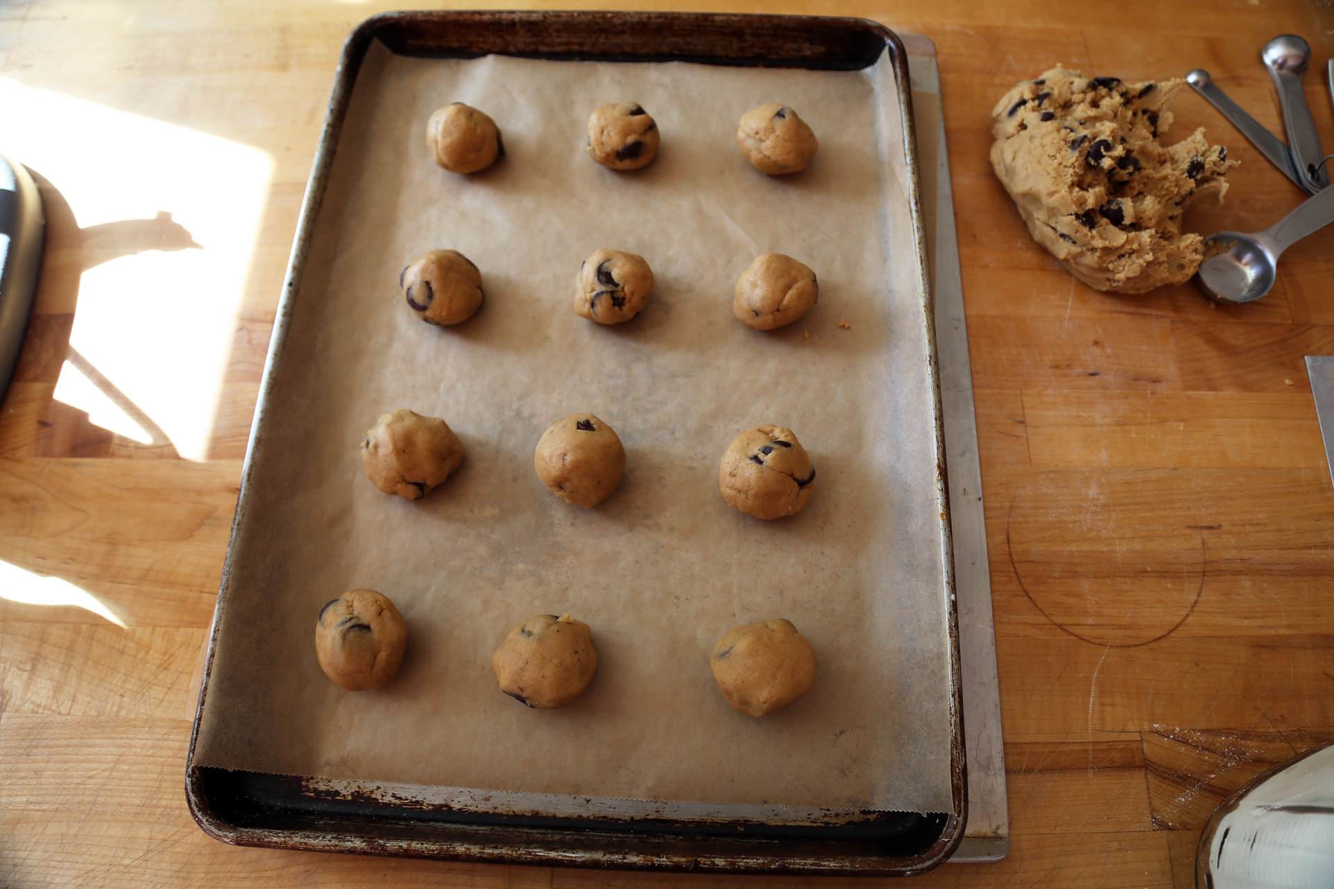 Roll tablespoonfuls of the dough into balls and space evenly on the baking sheets.