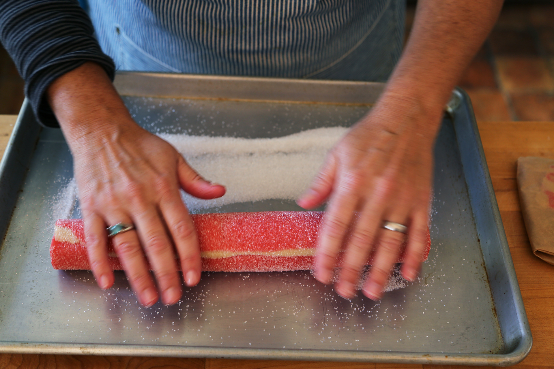 Roll the log in the sparkle sugar, pressing slightly to make sure it adheres to the dough.