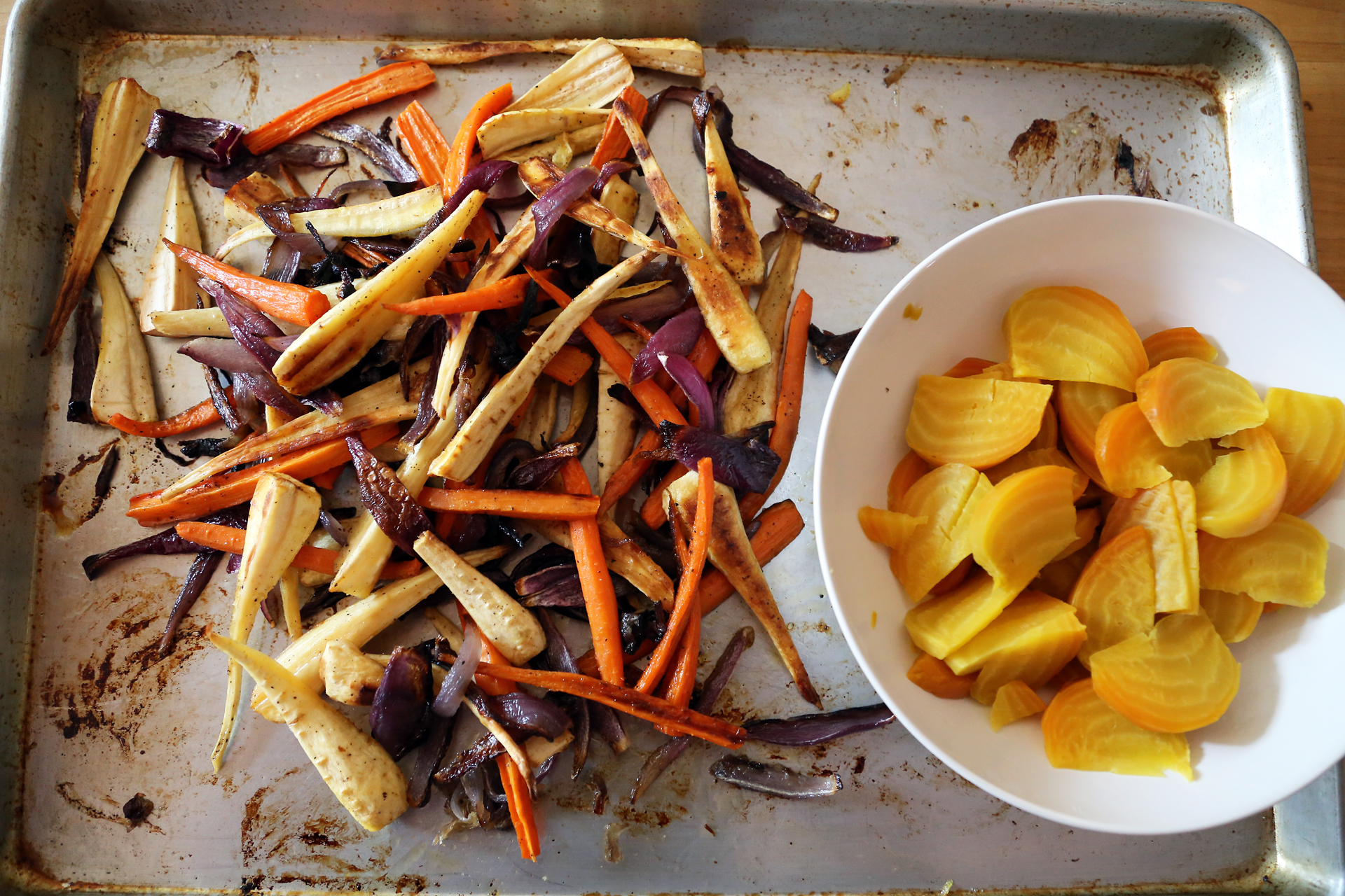 Roast the vegetables until just tender, about 40 minutes, turning occasionally for even cooking. Let cool to room temperature on the pan.