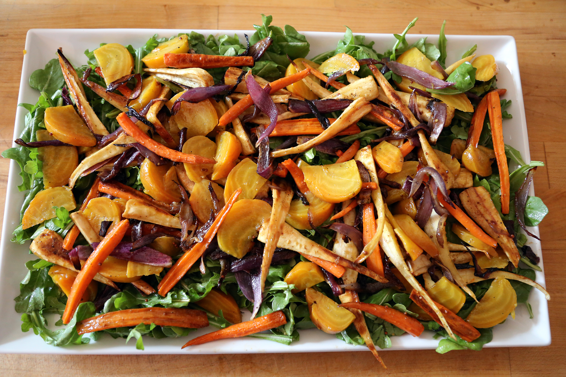 Top the arugula with the roasted vegetables.
