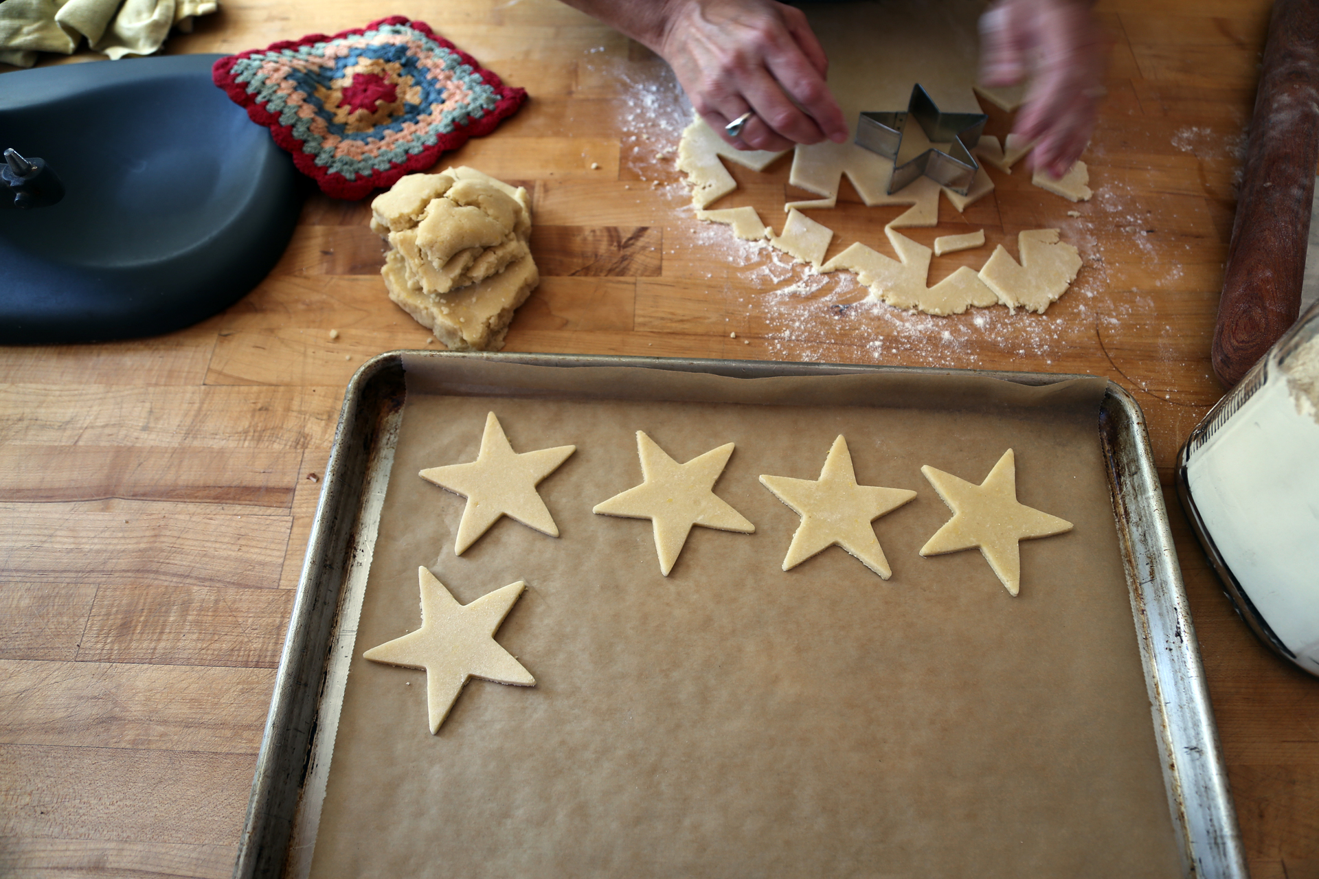 Using a 3 1/2-inch star-shaped cookie cutters (or the cutters of your choice), cut out as many rounds as possible, spacing them slightly apart.