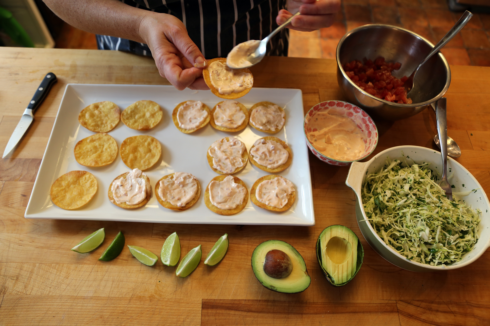 For each tostada, spread a little of the mayo mixture on the tostada shell.