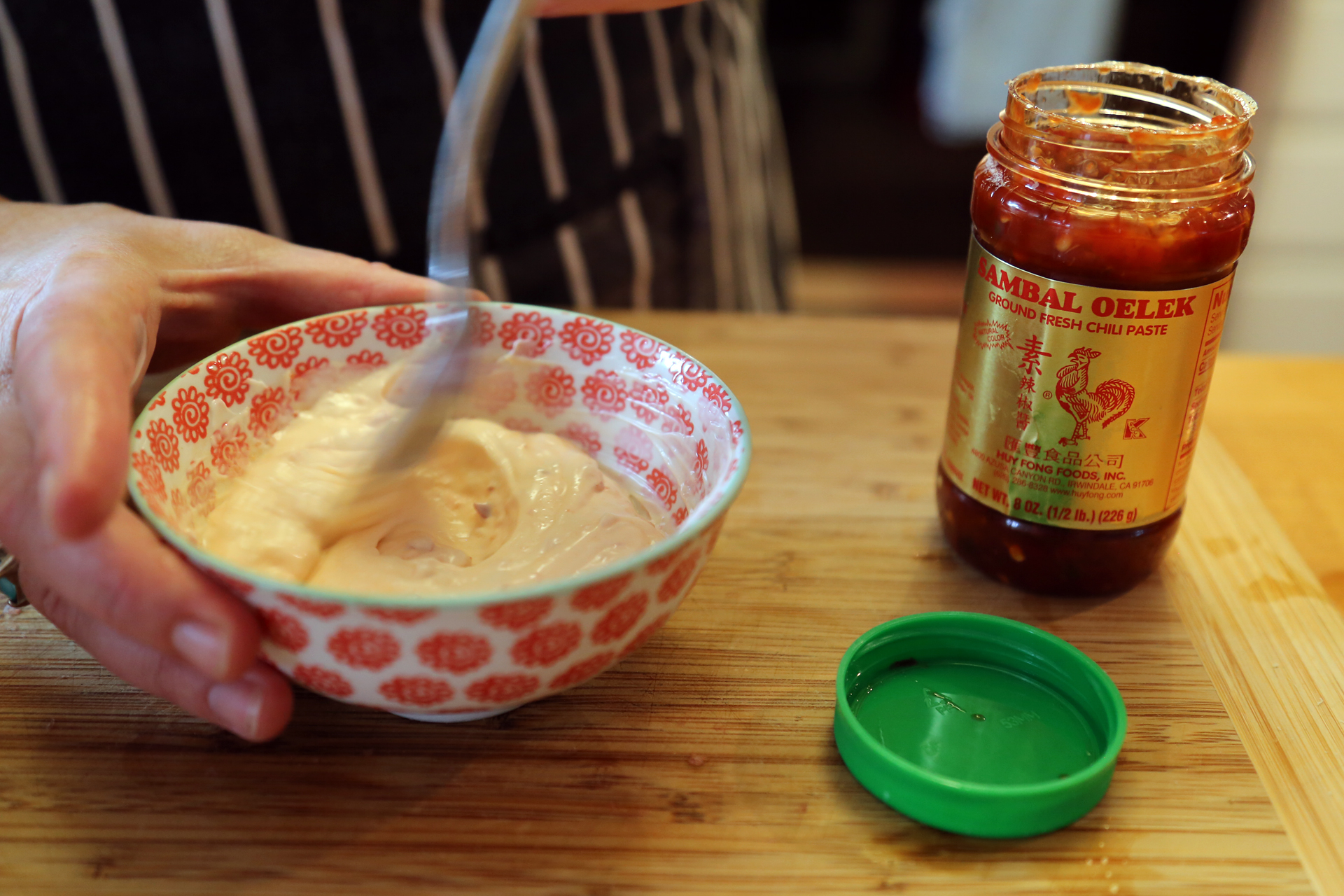 In another bowl, stir together the mayo and sambal oelek; cover and refrigerate.