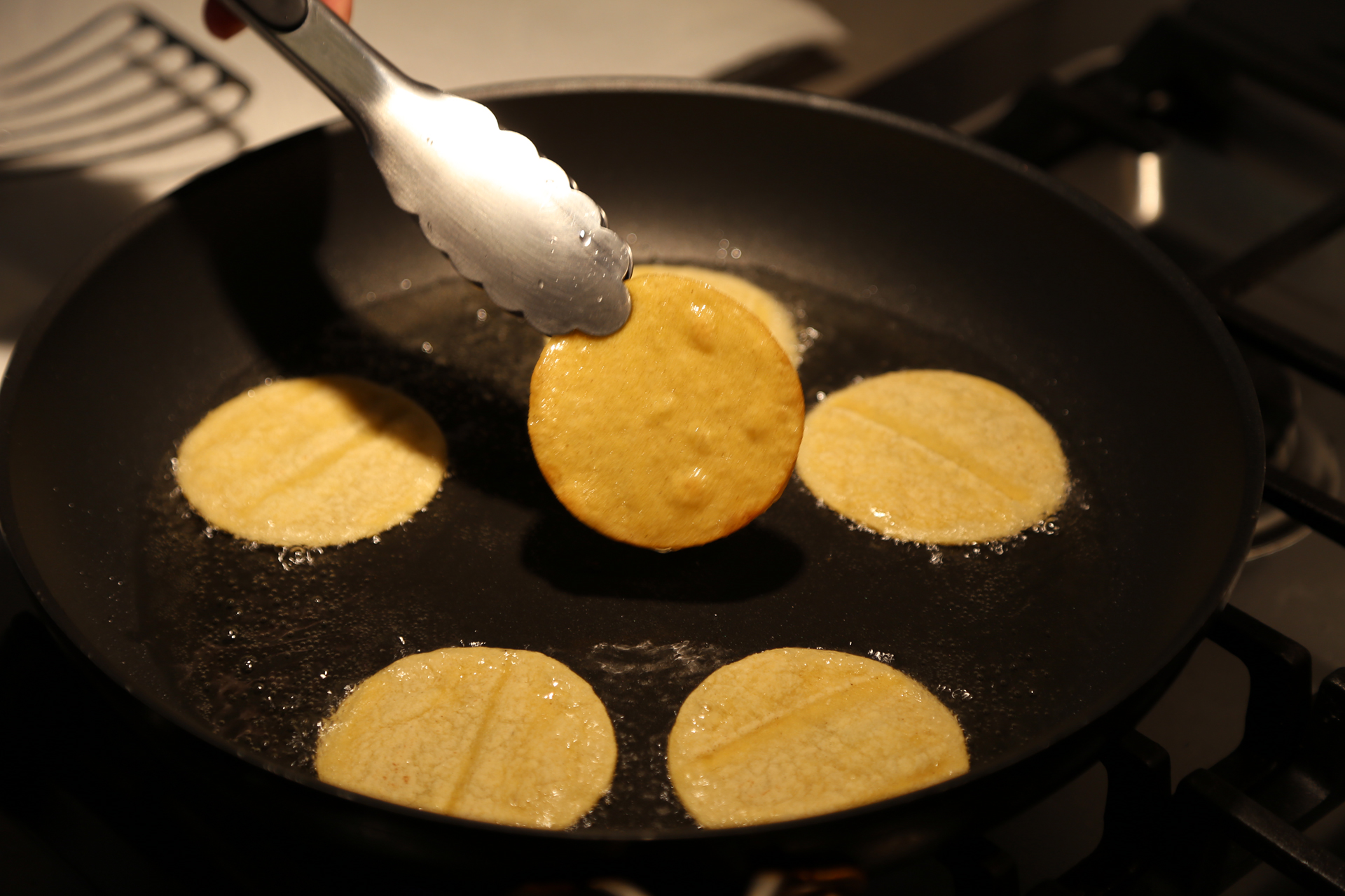Fry the tortilla rounds until crisp.Transfer to a wire rack lined with paper towels and set over a baking sheet to drain.