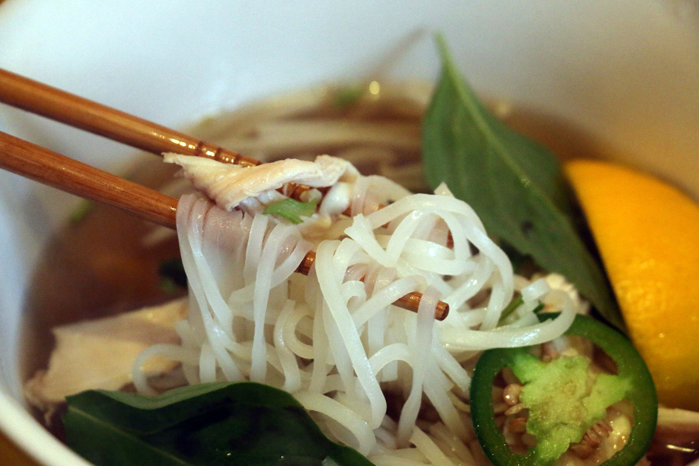 A hearty bowl of Pho Ga (chicken) at Pho 84 in downtown Oakland.  Kim Westerman