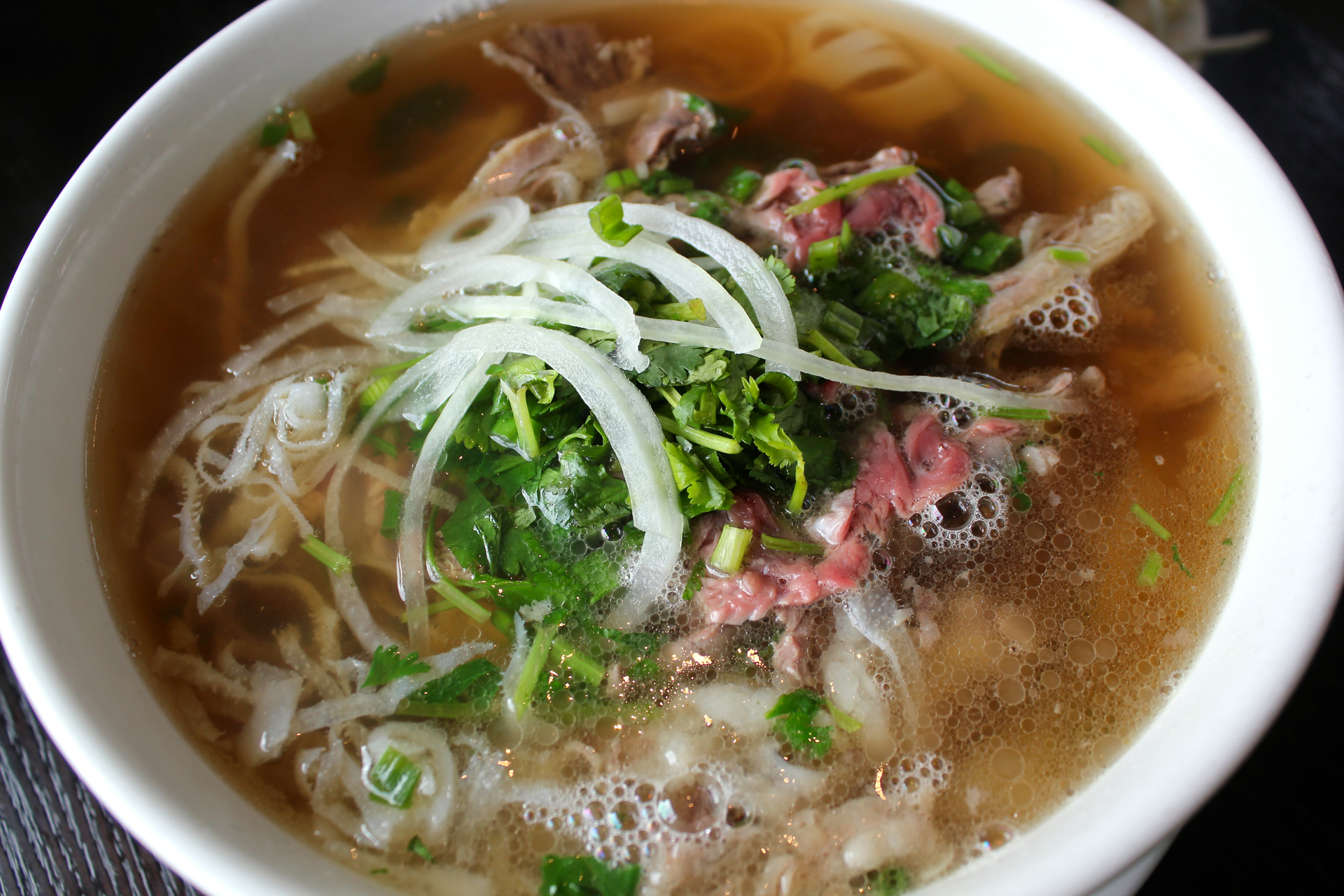 Pho dac biet at Pho Factory with rare filet mignon, well-done flank, brisket, tendon and tripe.