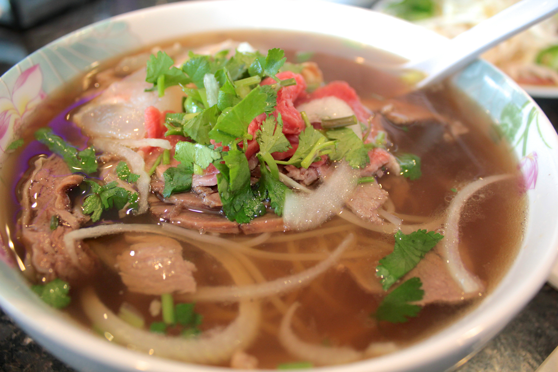The popular #8 combination pho with rare filet mignon, well-done brisket, flank and tendon.