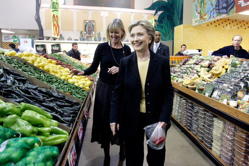 Democratic presidential hopeful Hillary Clinton walks through the hot peppers section of the El Rey grocery store in Milwaukee, Wis., during a campaign stop in 2008. Clinton tells NPR that she eats a hot, fresh pepper a day to stay healthy on the campaign trail. She may be onto something.