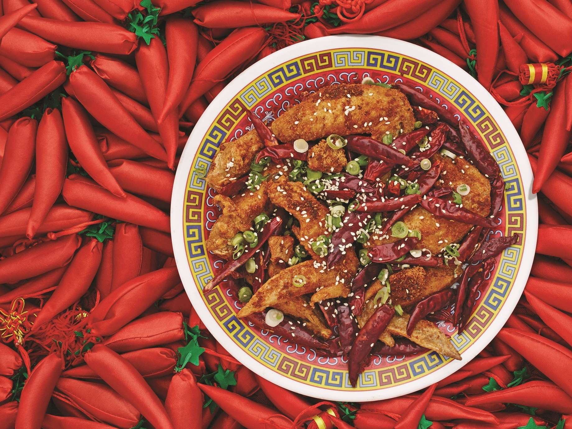 "Danny Bowien says Szechuanese cuisine is ""really about balance and restraint and not having things be over-the-top spicy."" Bowien's Chongqing Chicken Wings, featured in The Mission Chinese Cookbook, are pictured above."