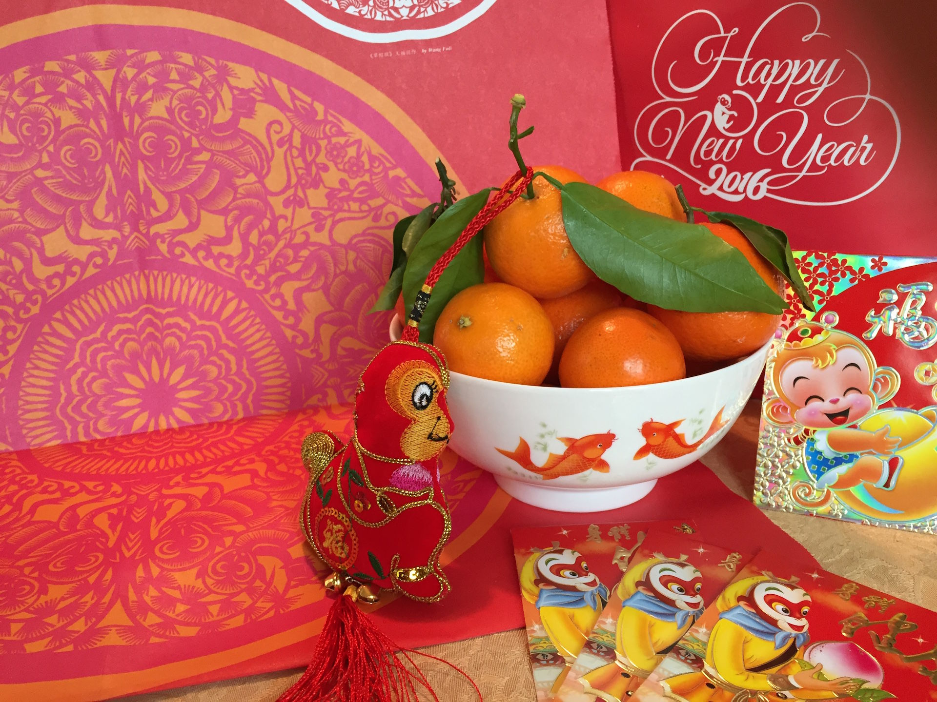 "Celebrate the Lunar New Year of the Monkey with tangerines, koi, red and gold. Photo"" Anna Mindess"