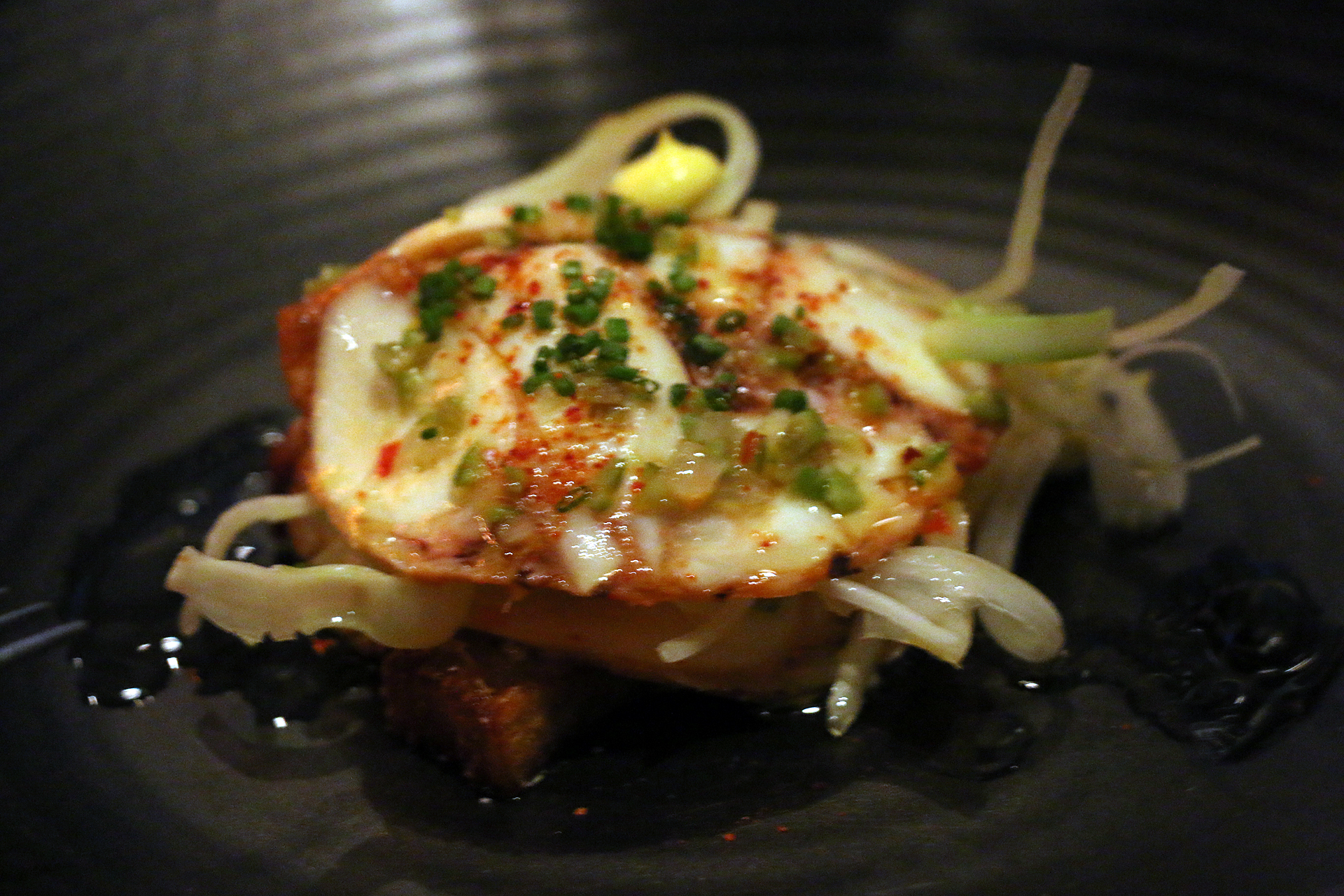 Octopus mille-feuille with pommes Anna, Castelvetrano olives and saffron aioli.