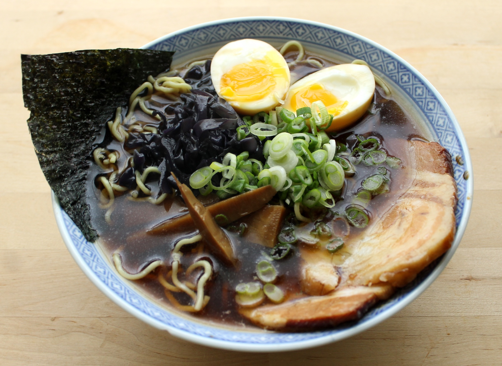 Homemade shoyu ramen with chashu, soy eggs, menma, cabbage, scallions, and nori.
