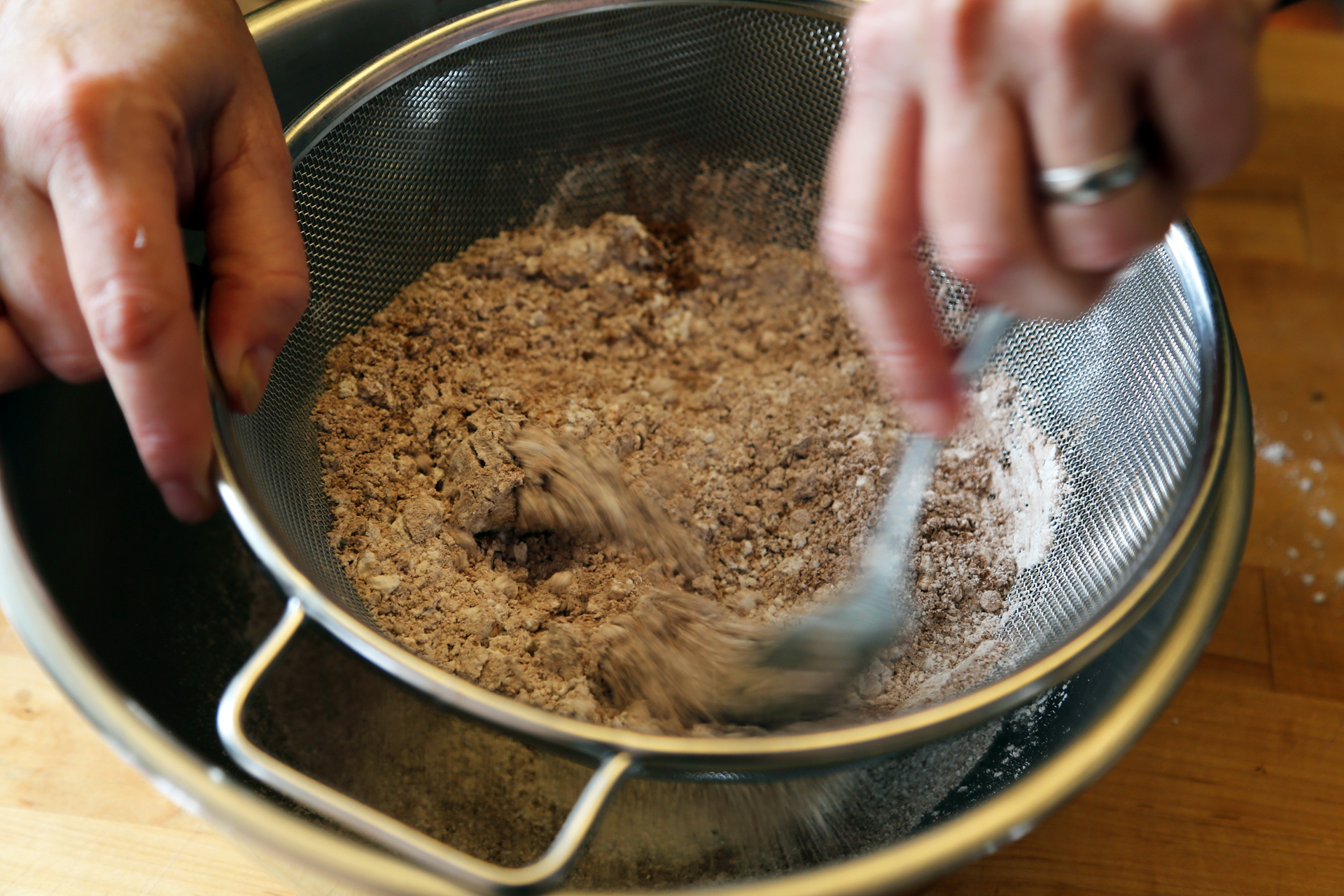 In a bowl, sift together the flour, cocoa powder, and baking powder.
