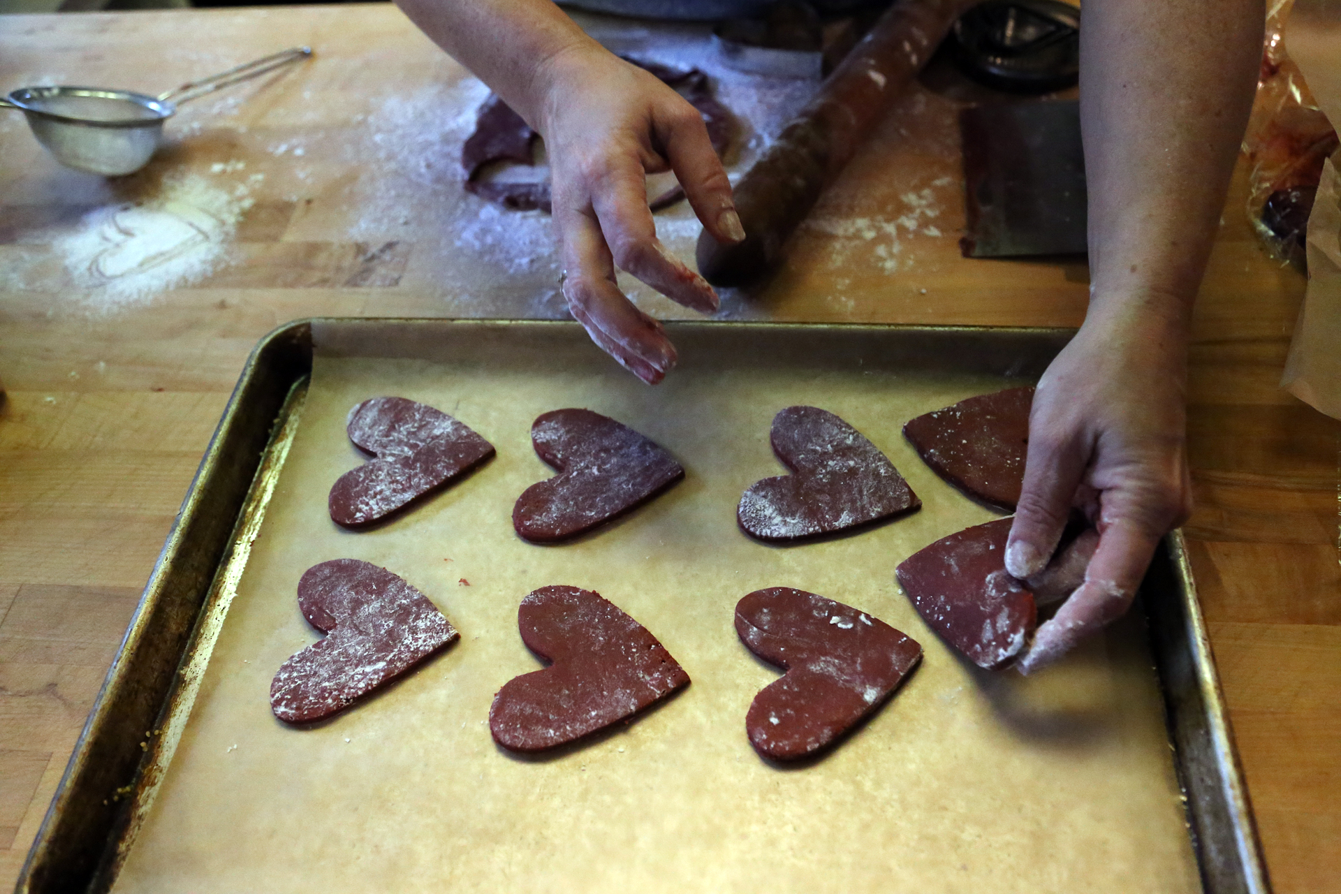 Using a 3-inch heart-shaped cookie cutter, cut out as many hearts as you can.