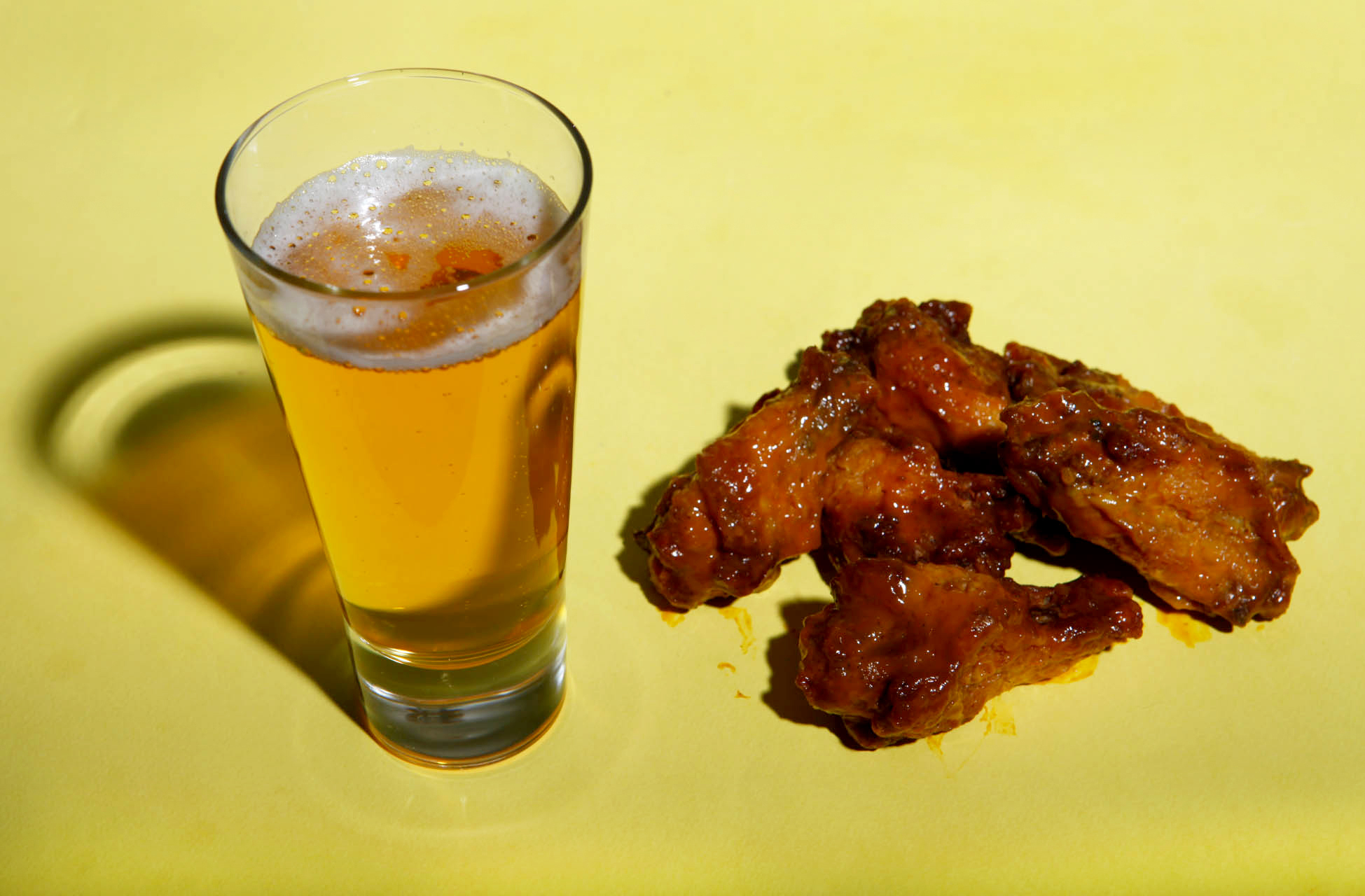 Buffalo wings paired with Mama's Little Yella Pils