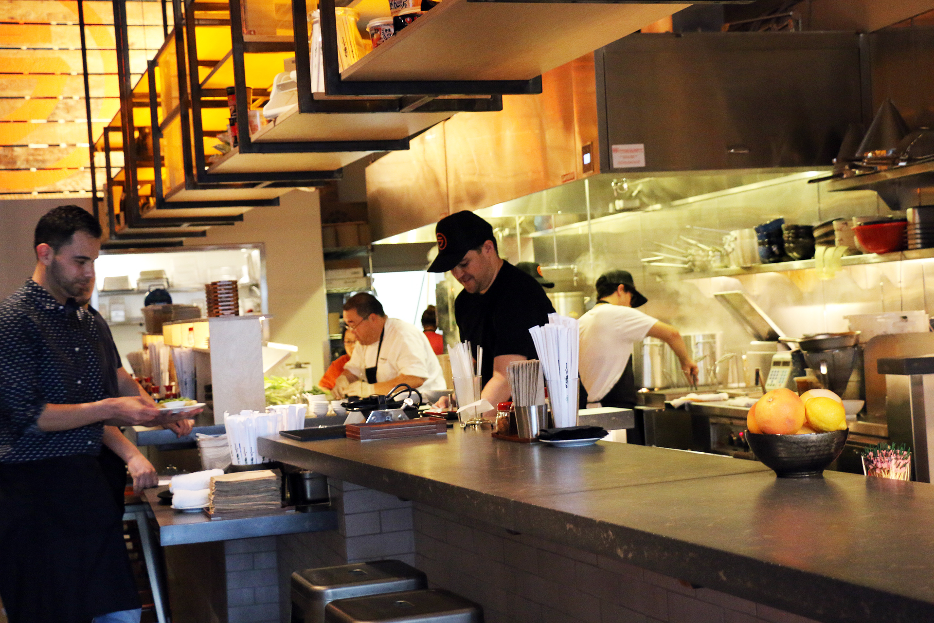 The fast-paced open kitchen at Itani Ramen.