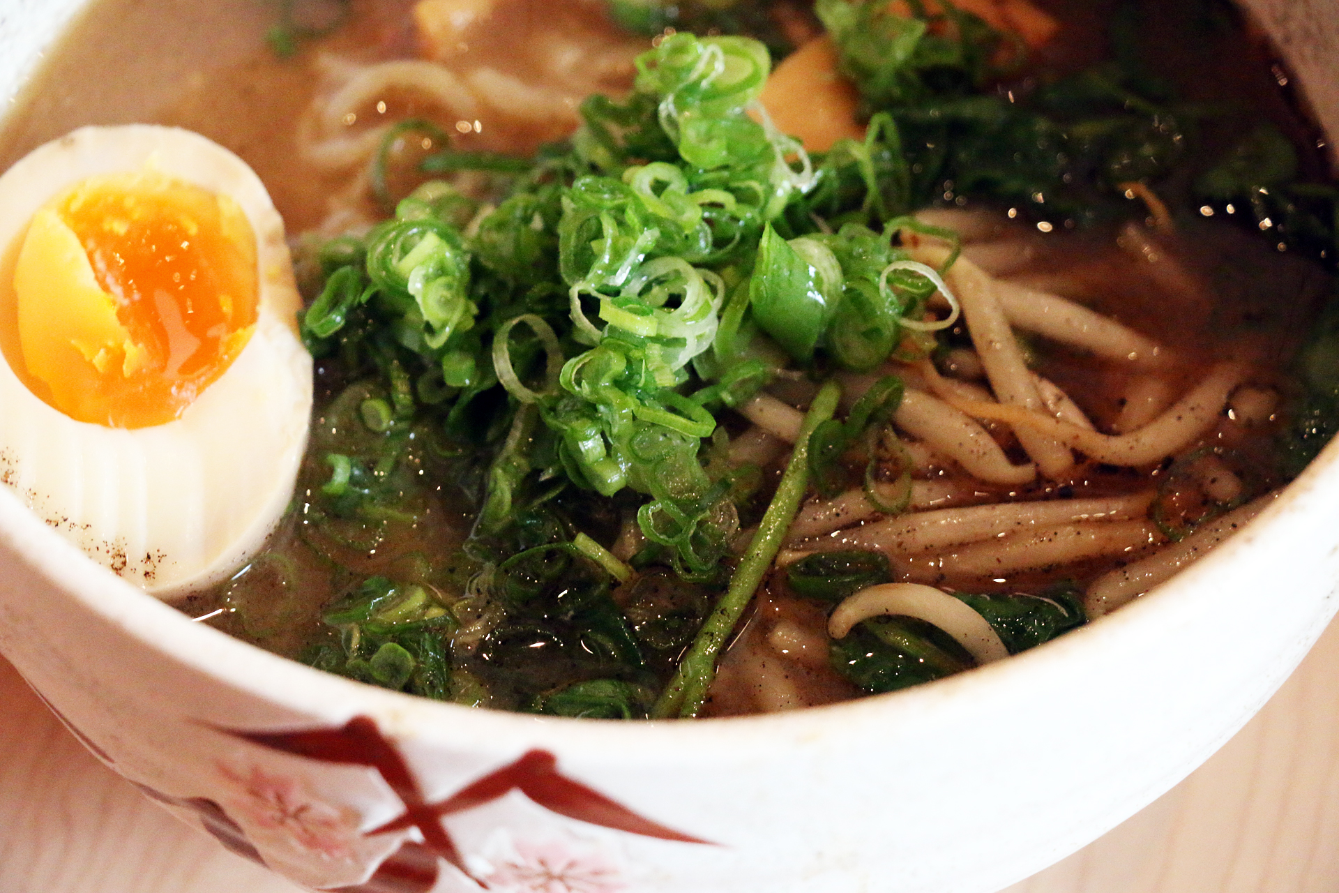 Miso ramen with watercress, bamboo shoots, bean sprouts and black garlic oil.