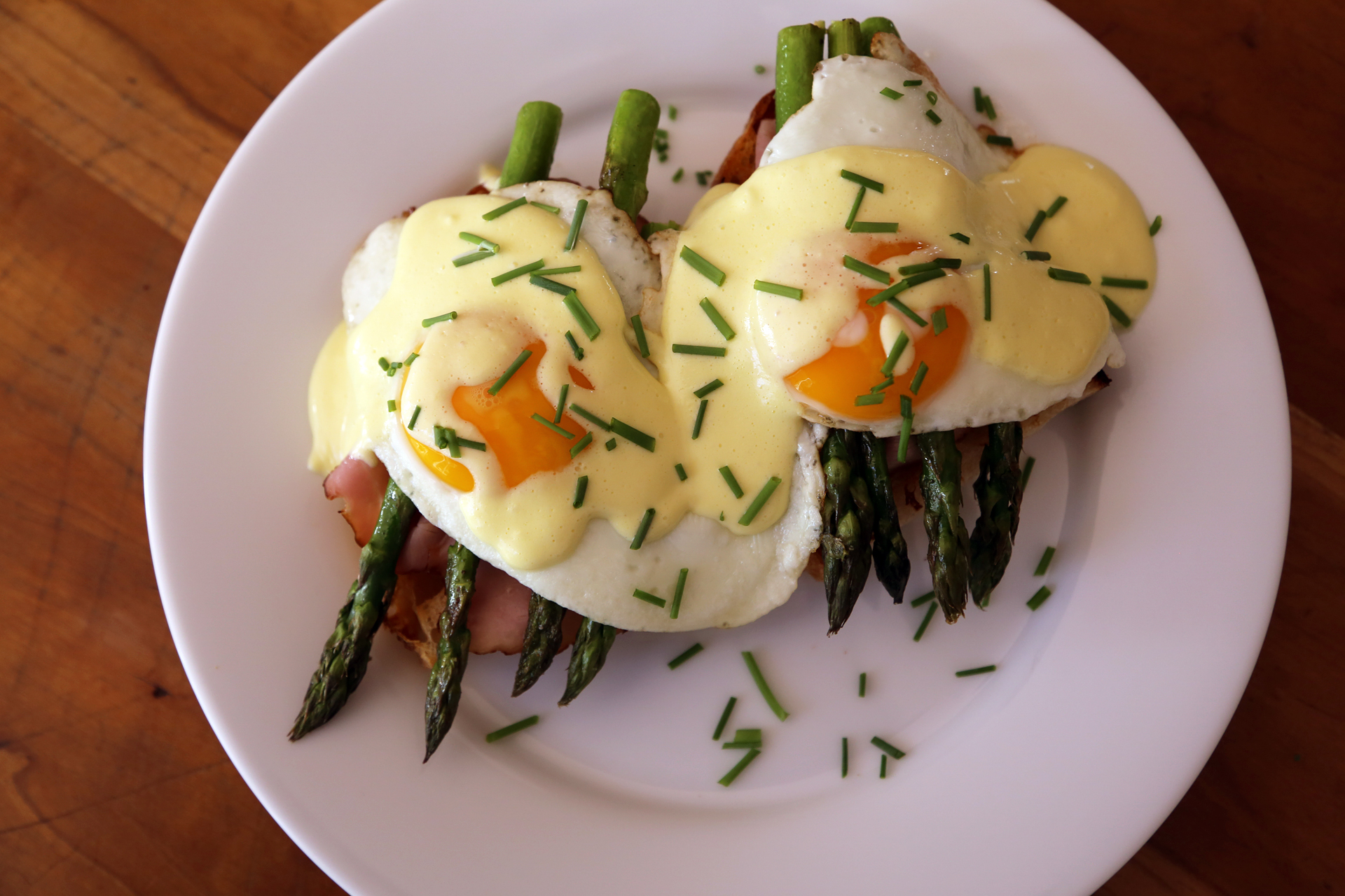 Springtime Eggs Benedict with Asparagus, Ham, and Quick Lemony Hollandaise Sauce