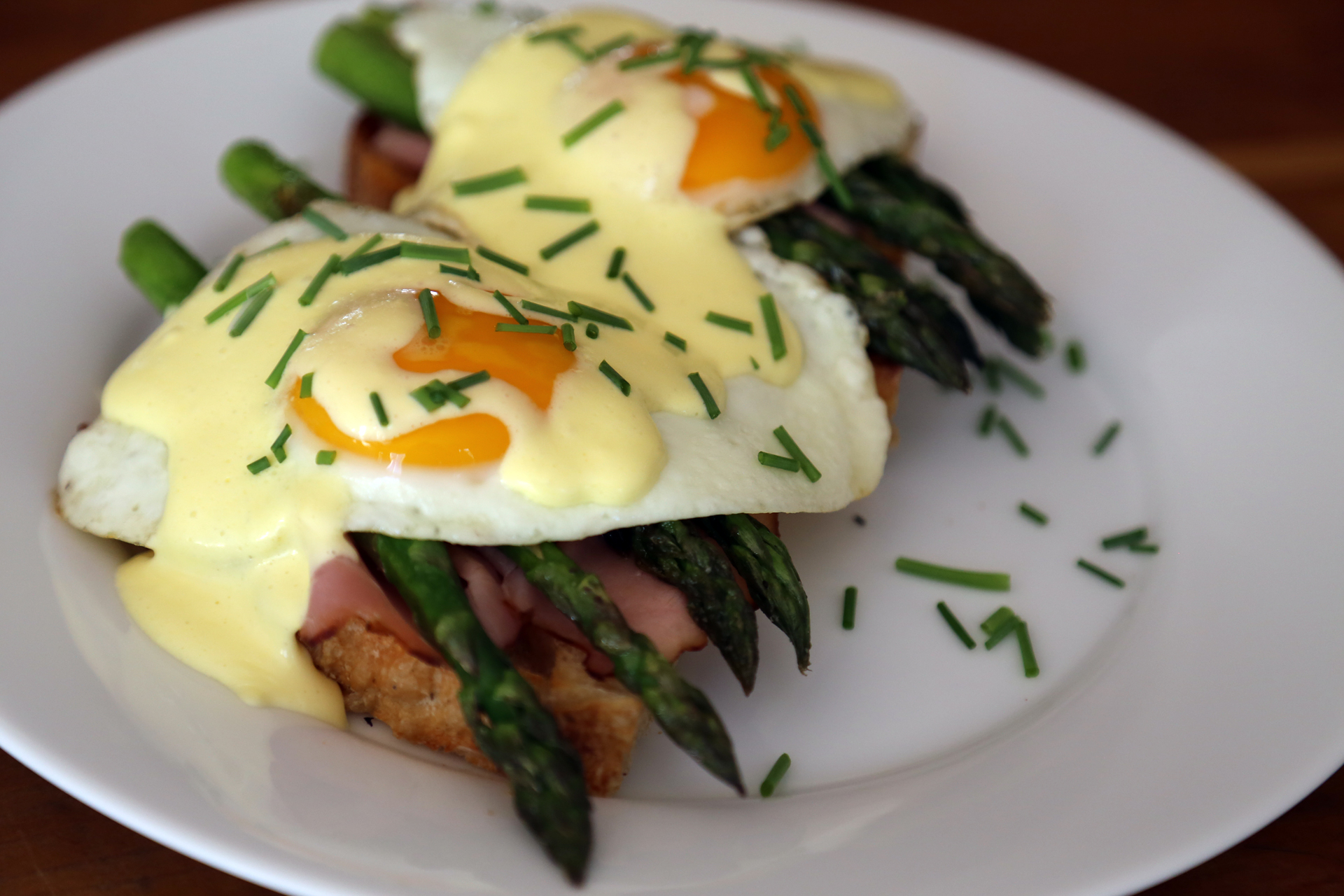 Easter brunch springtime eggs benedict with asparagus ham and quick