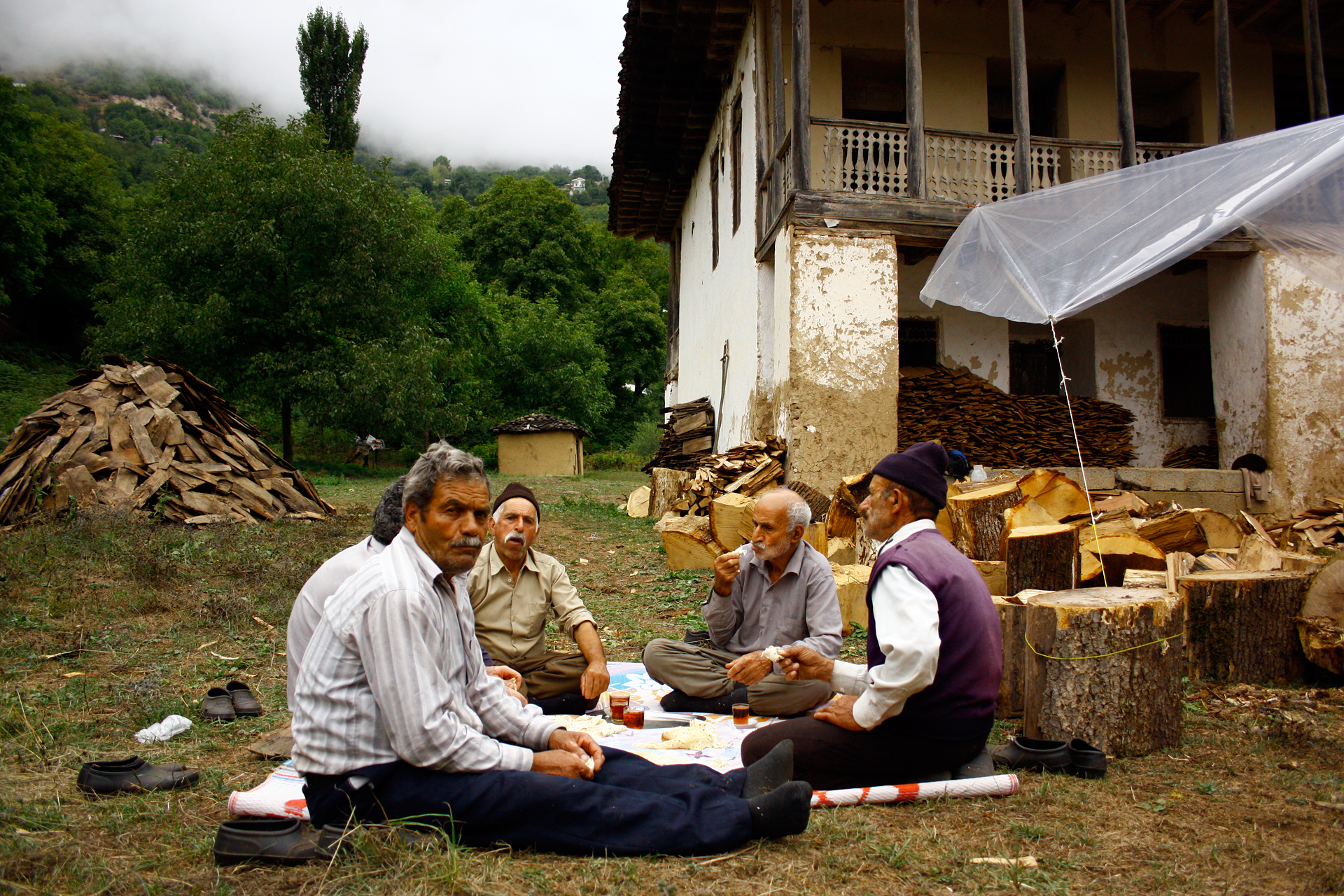 Local carpenters in Gilan, Iran drink tea in the afternoon. They made 15,000 wooden sheets of oak wood to repair the old house roof of his grandparent's farmhouse.