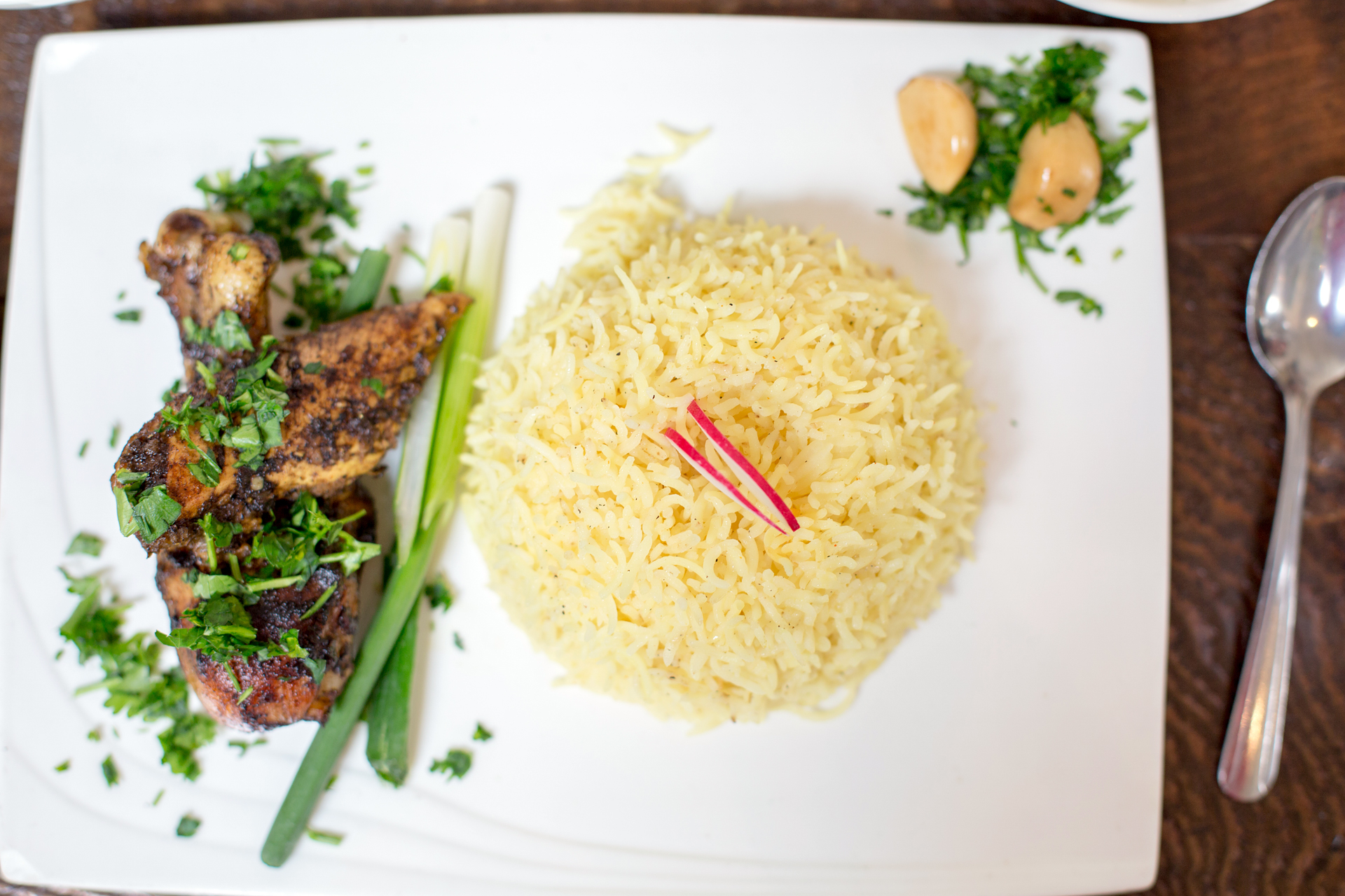 Komaaj serves turmeric rice with roasted chicken marinated in sour orange molasses, mountain cumin and Persian hogweed.