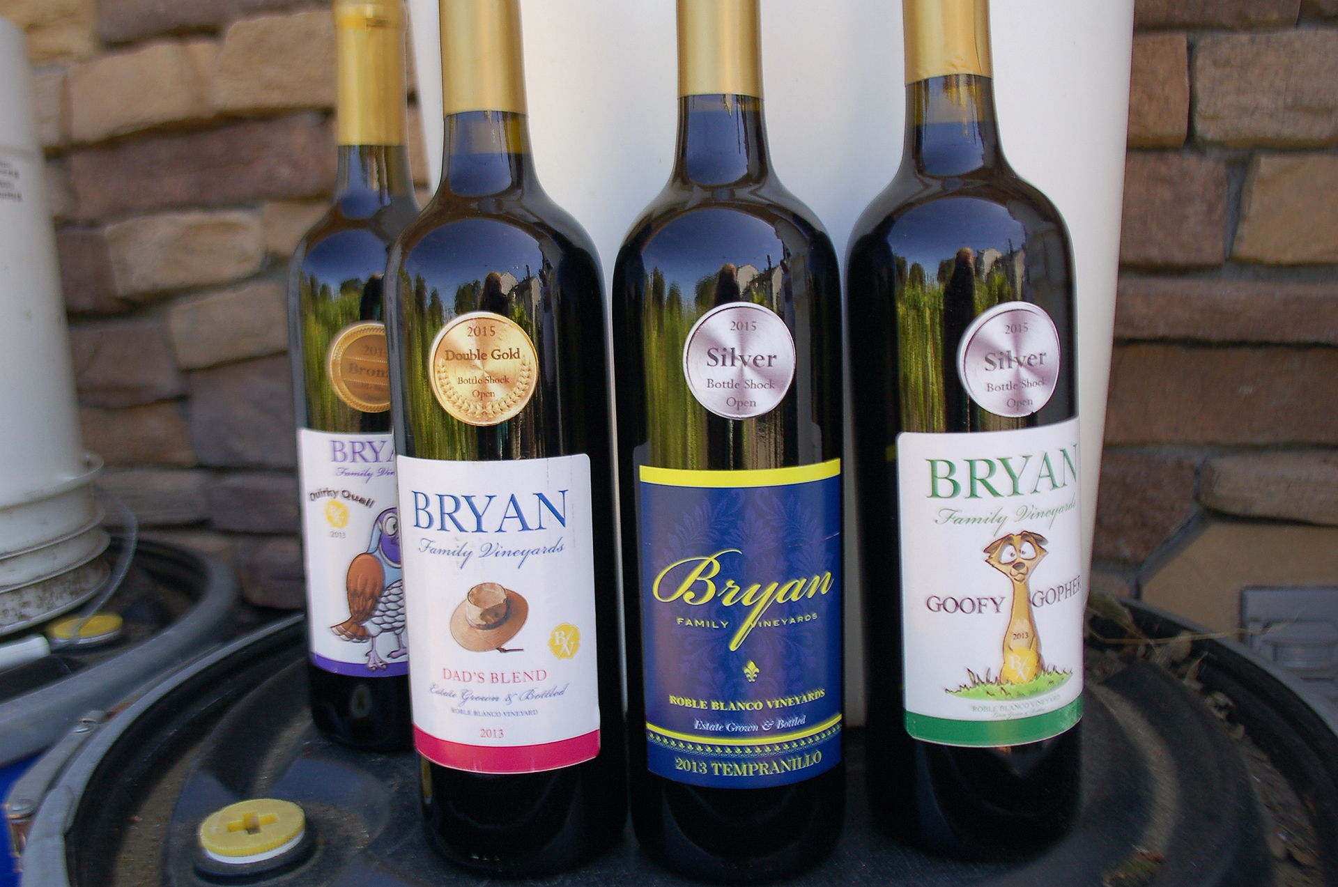 Scott Bryan's serious winemaking hobby has earned him medals at home winemaking competitions. His wines have humorous names like Goofy Gopher, Quirky Quail and Dad's Blend.